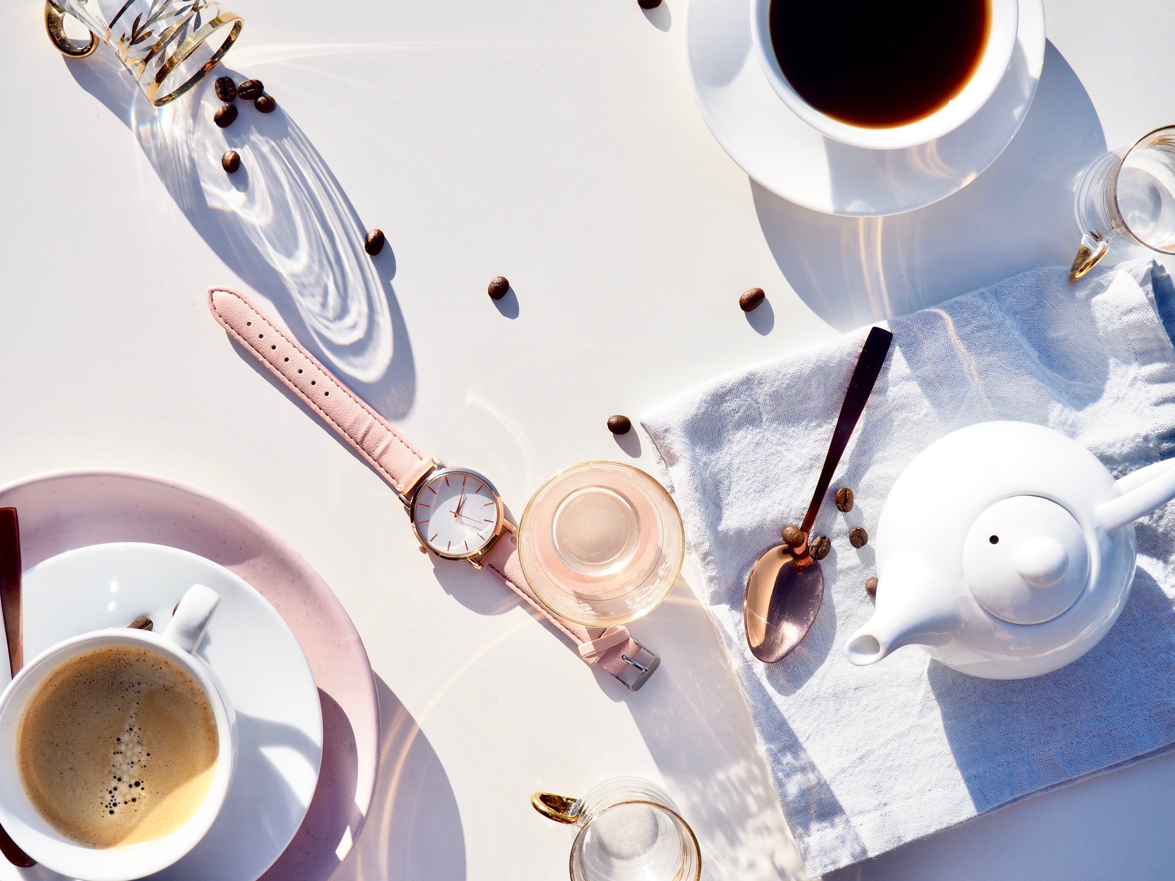 Spoon, Watch, Cups, and Kettle on Table