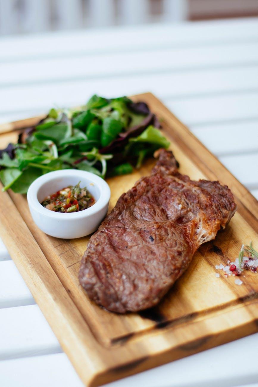 Tomahawk Steak and Sautéed Spinach
