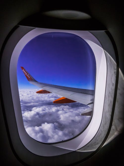 Airplane Window Overlooking Clouds