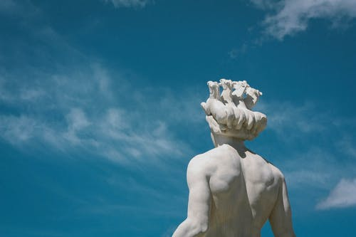 Human Statue Under Clear Sky