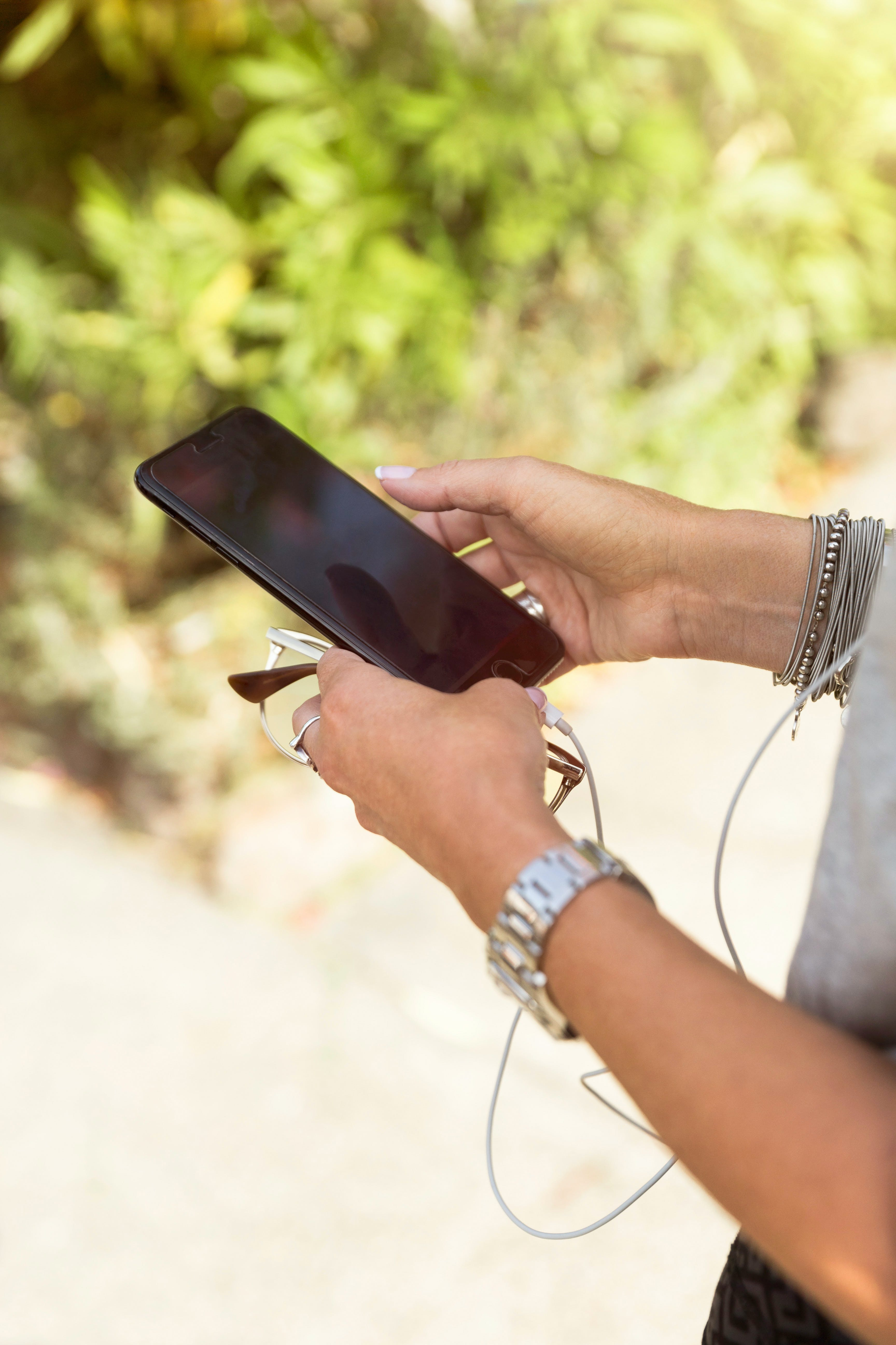 Woman Using Black Iphone 7at Daytime
