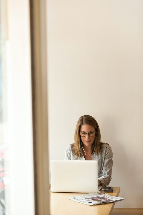 Woman Sitting While Using Laptop