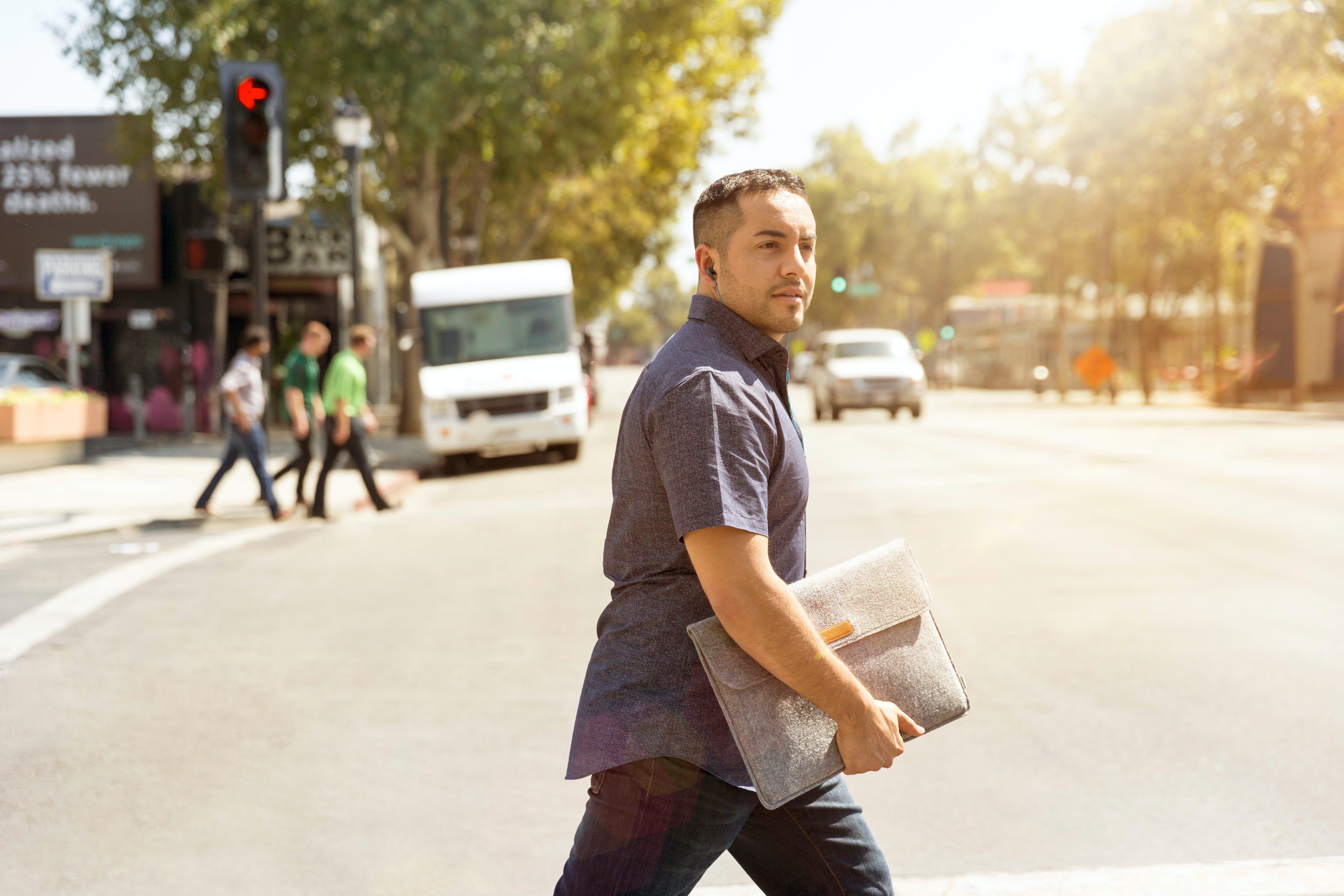 Man Holding Folder Crossing the Road