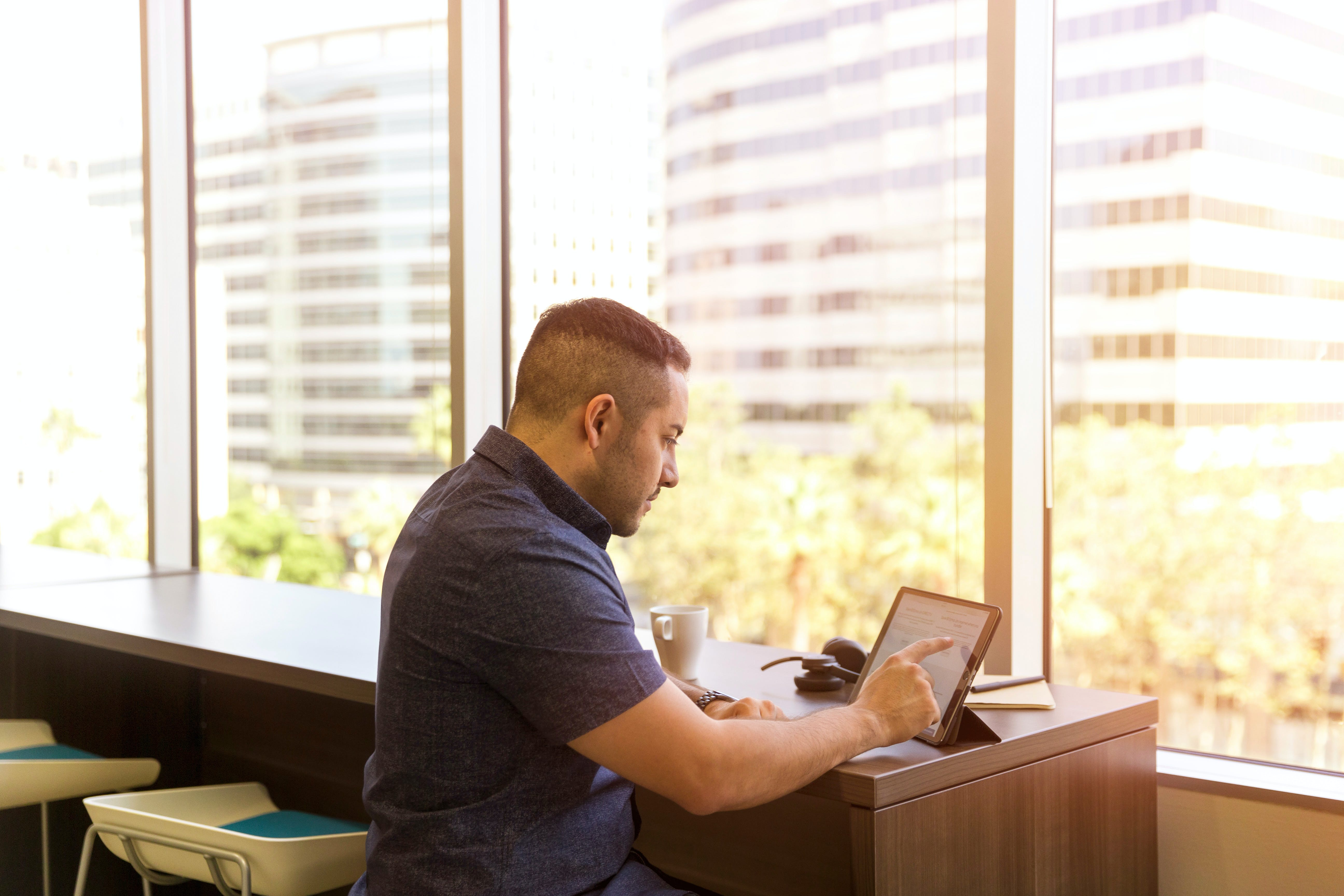 Man Sitting in Front of His Laptop