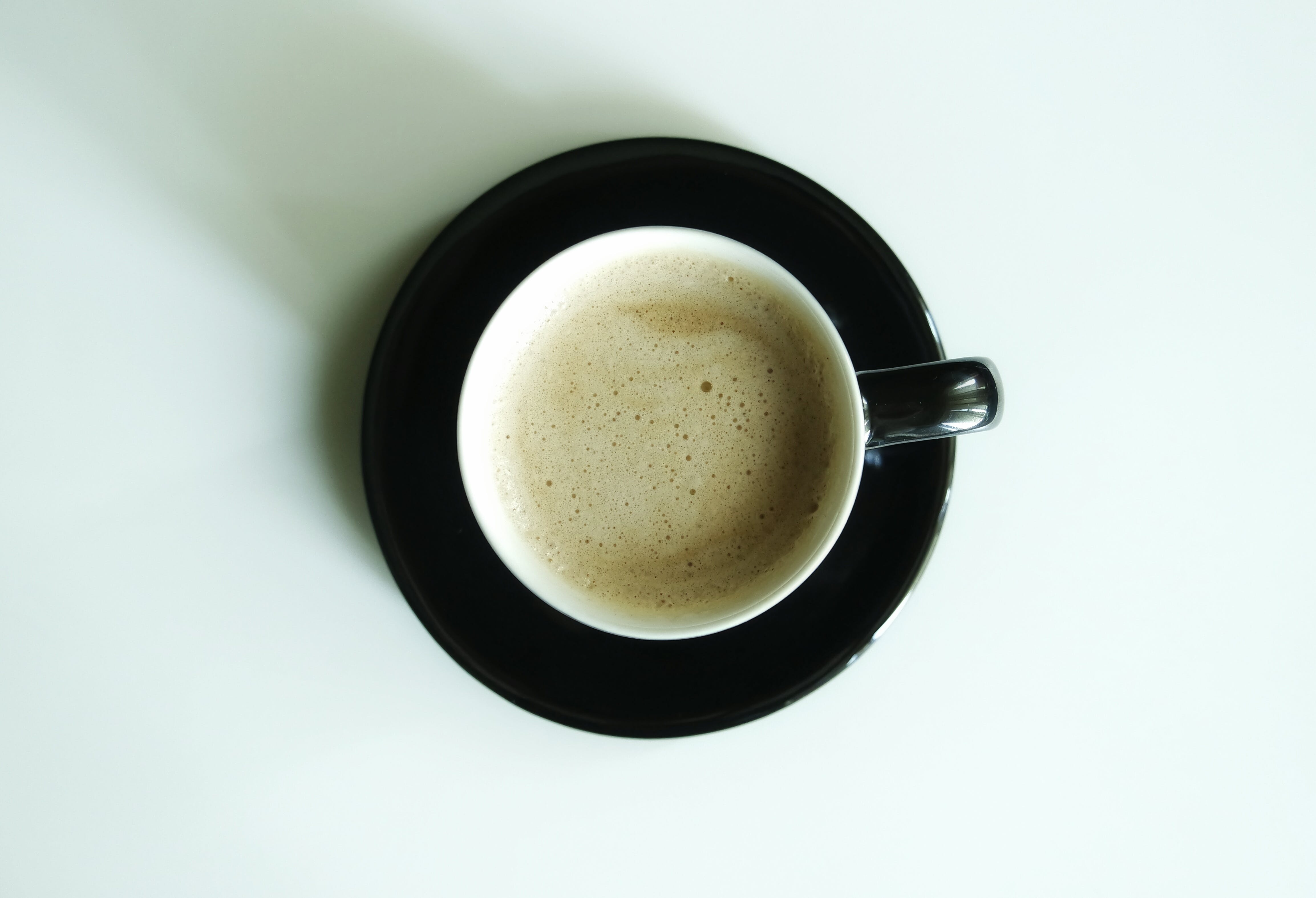 Flat Lay Photography of Latte Inside White Ceramic Mug