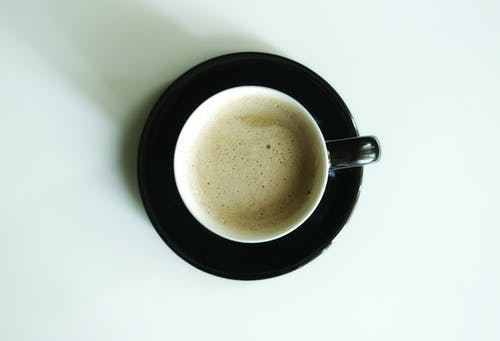 Flat Lay Photography of Latte Inside White Ceramic Mug