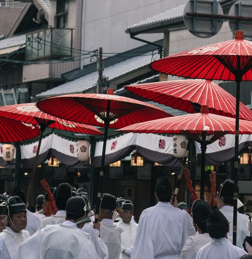 People Under Red Umbrellas