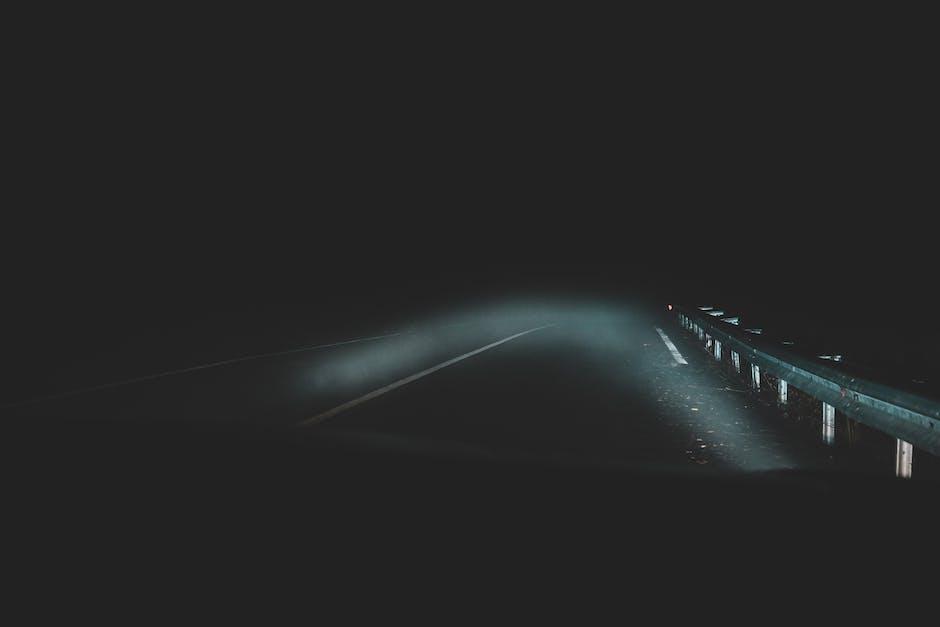 Car running on dark road at night