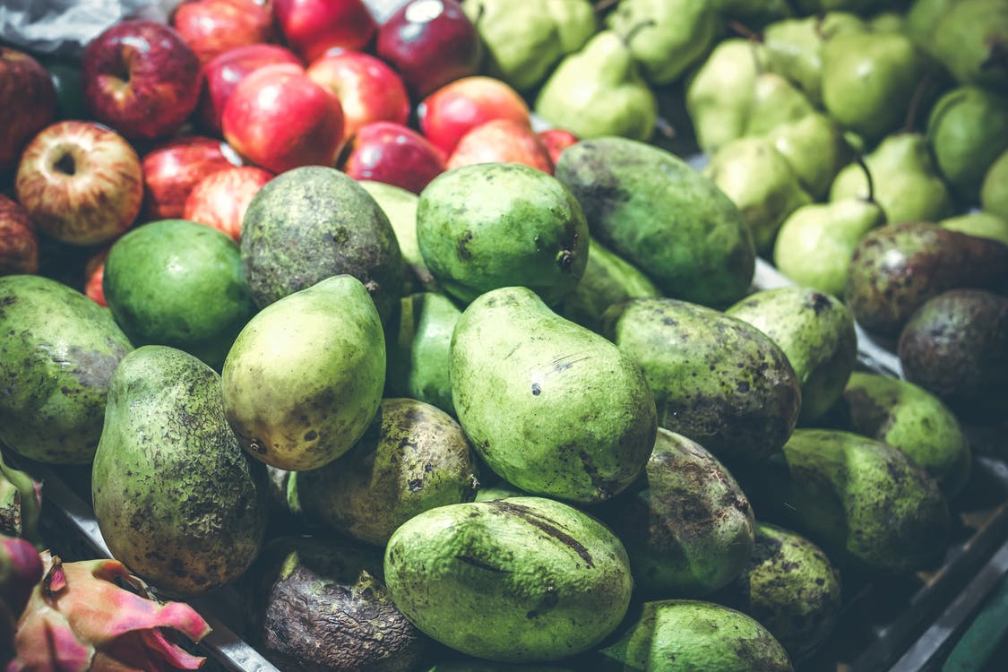 Green Mangoes and Red Apples