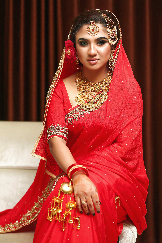 Woman Sitting and Wearing Red Anarkali Dress