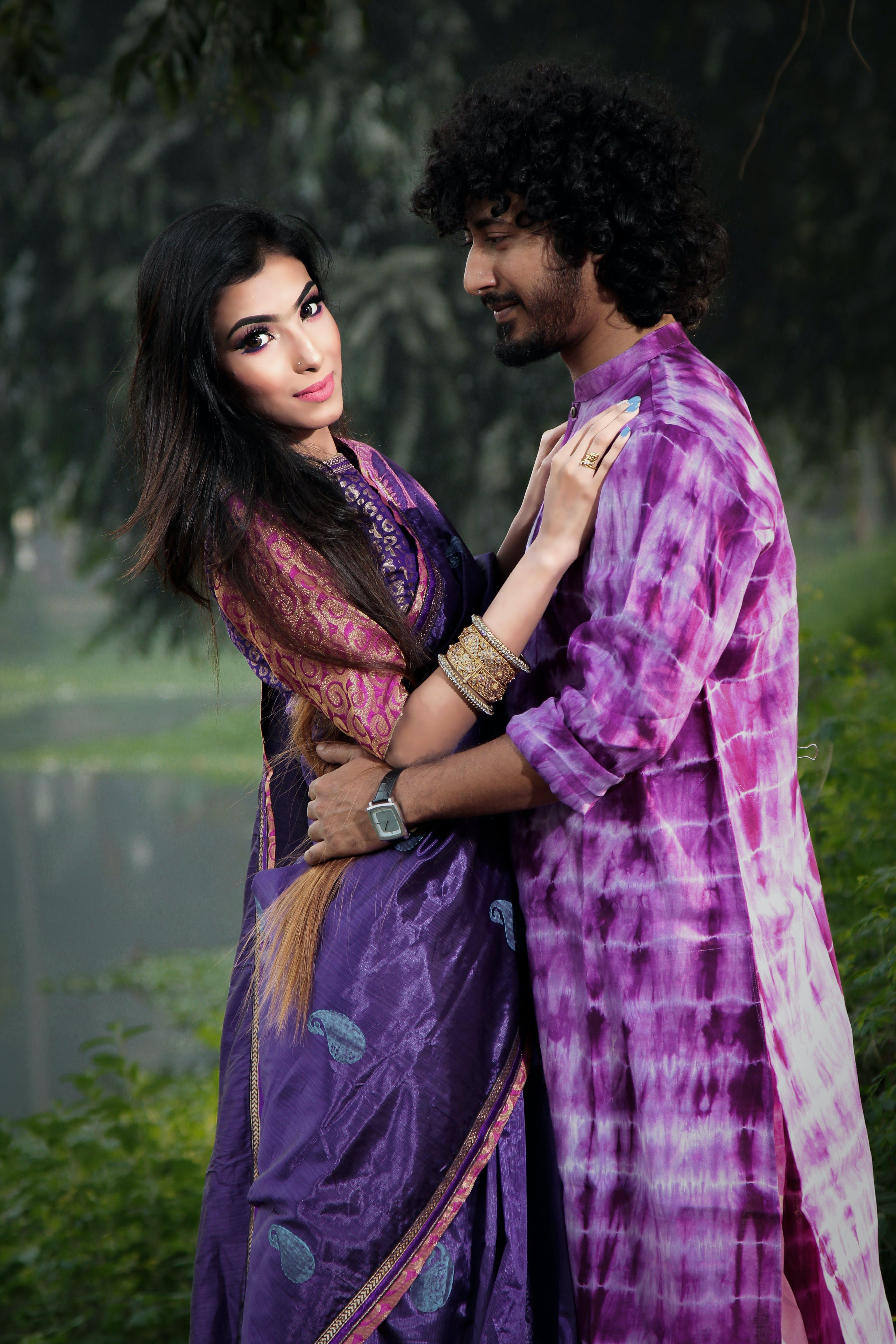 Photo of Man Holding Woman