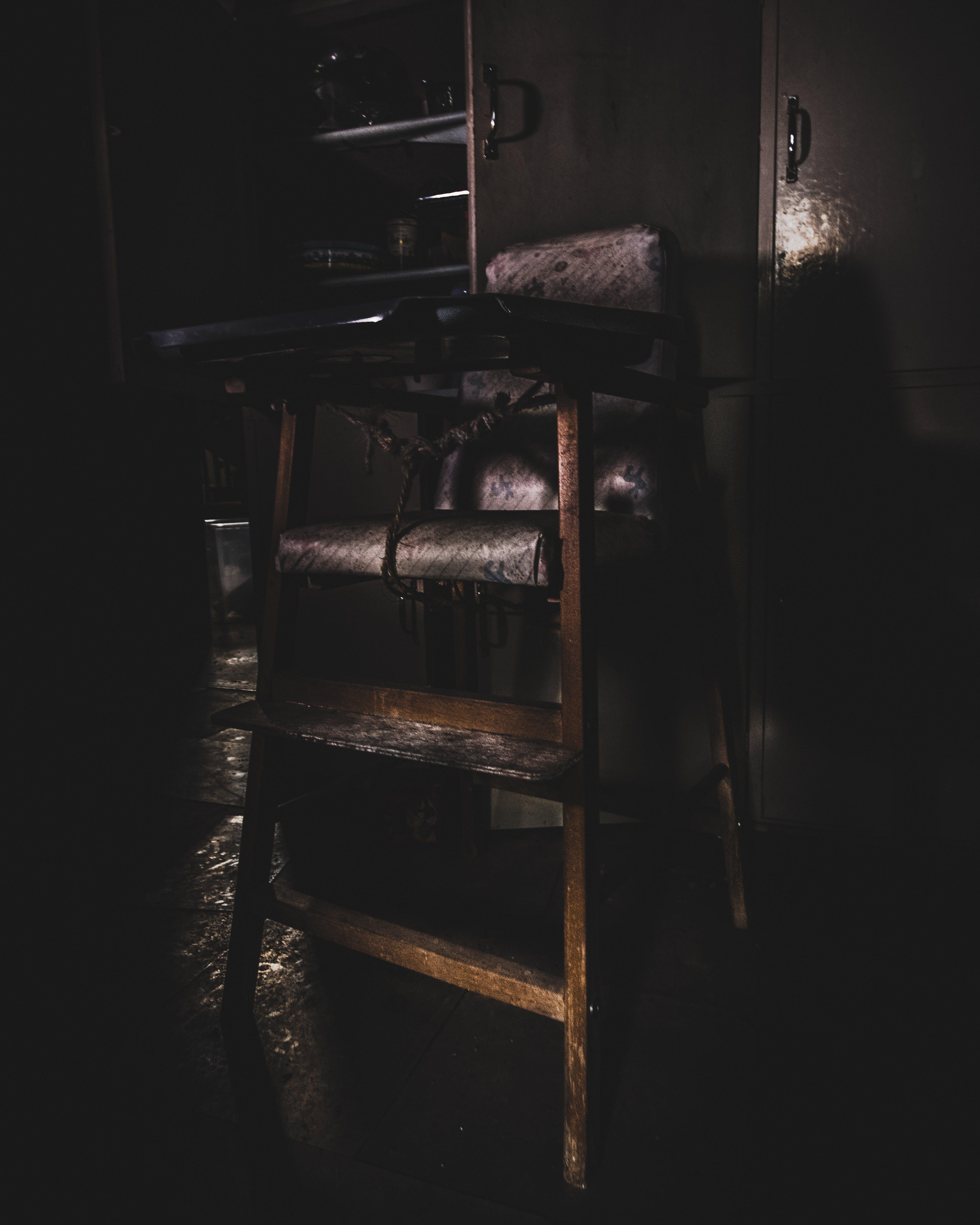 Baby's Wooden Highchair in Dim Light