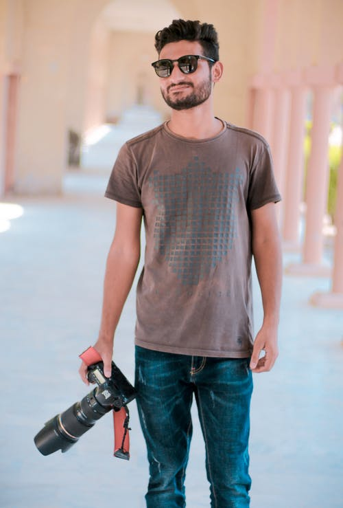Smiling Man Holding Black Dslr Camera