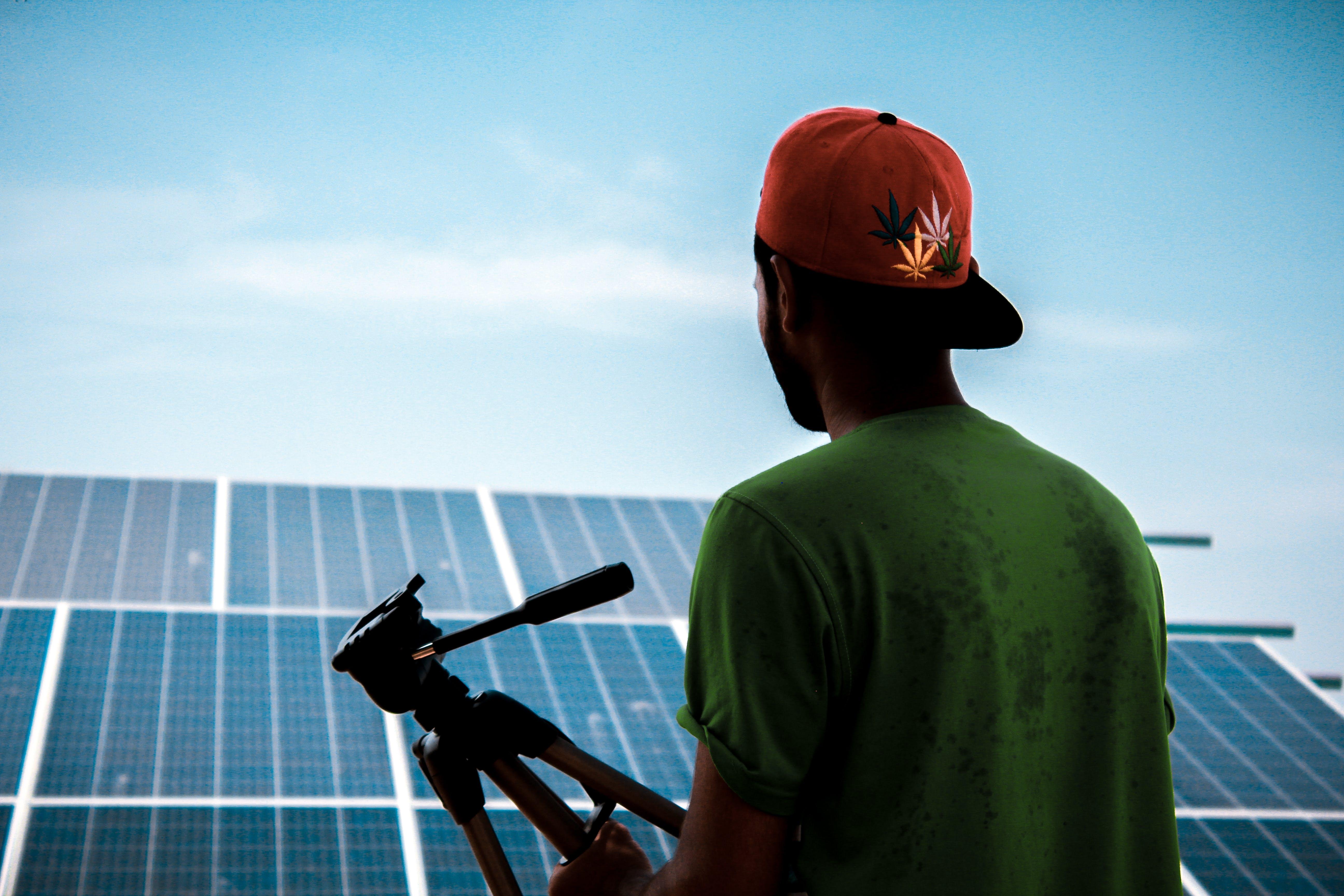 Man Facing Solar Panels