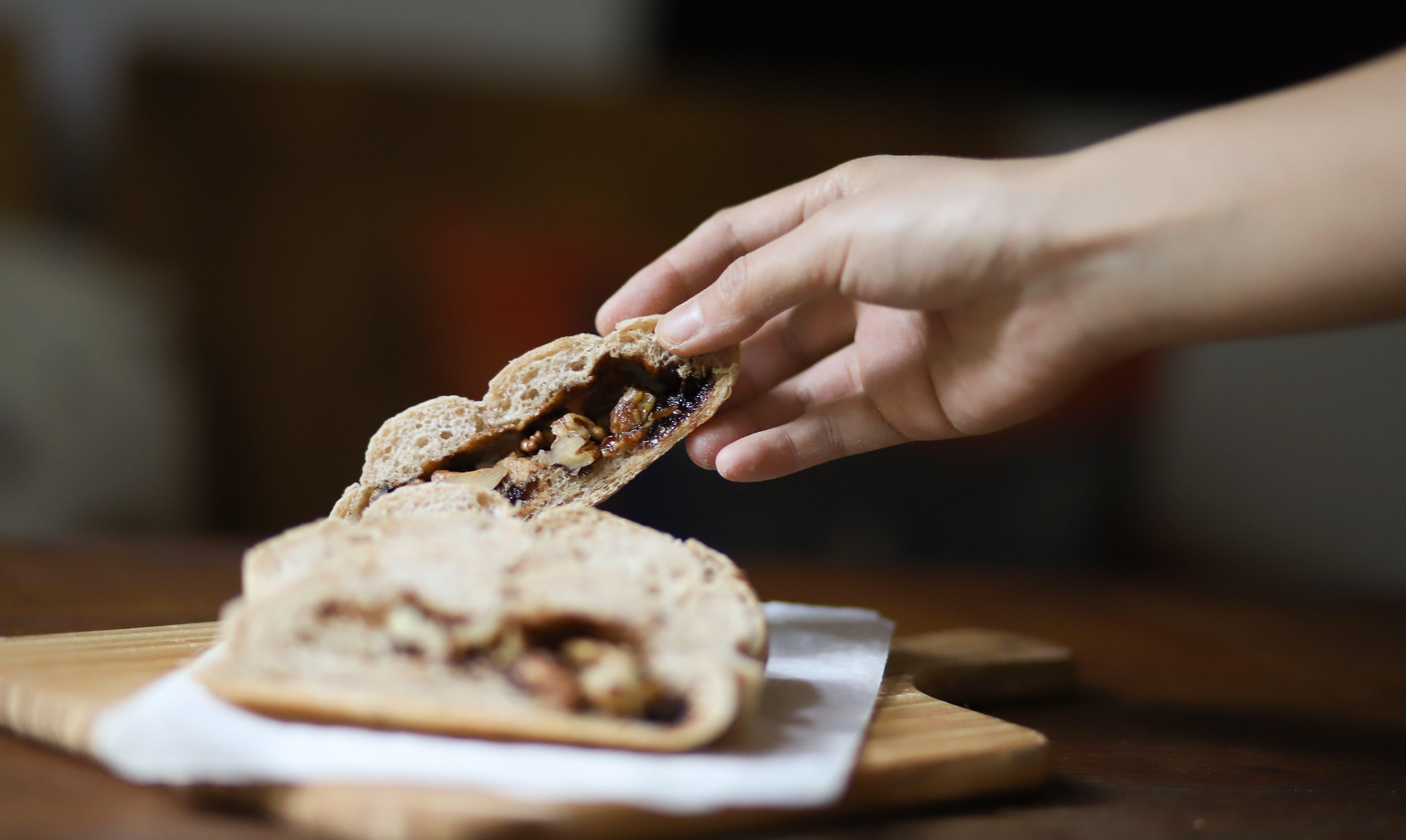 Person Getting Slice Bread