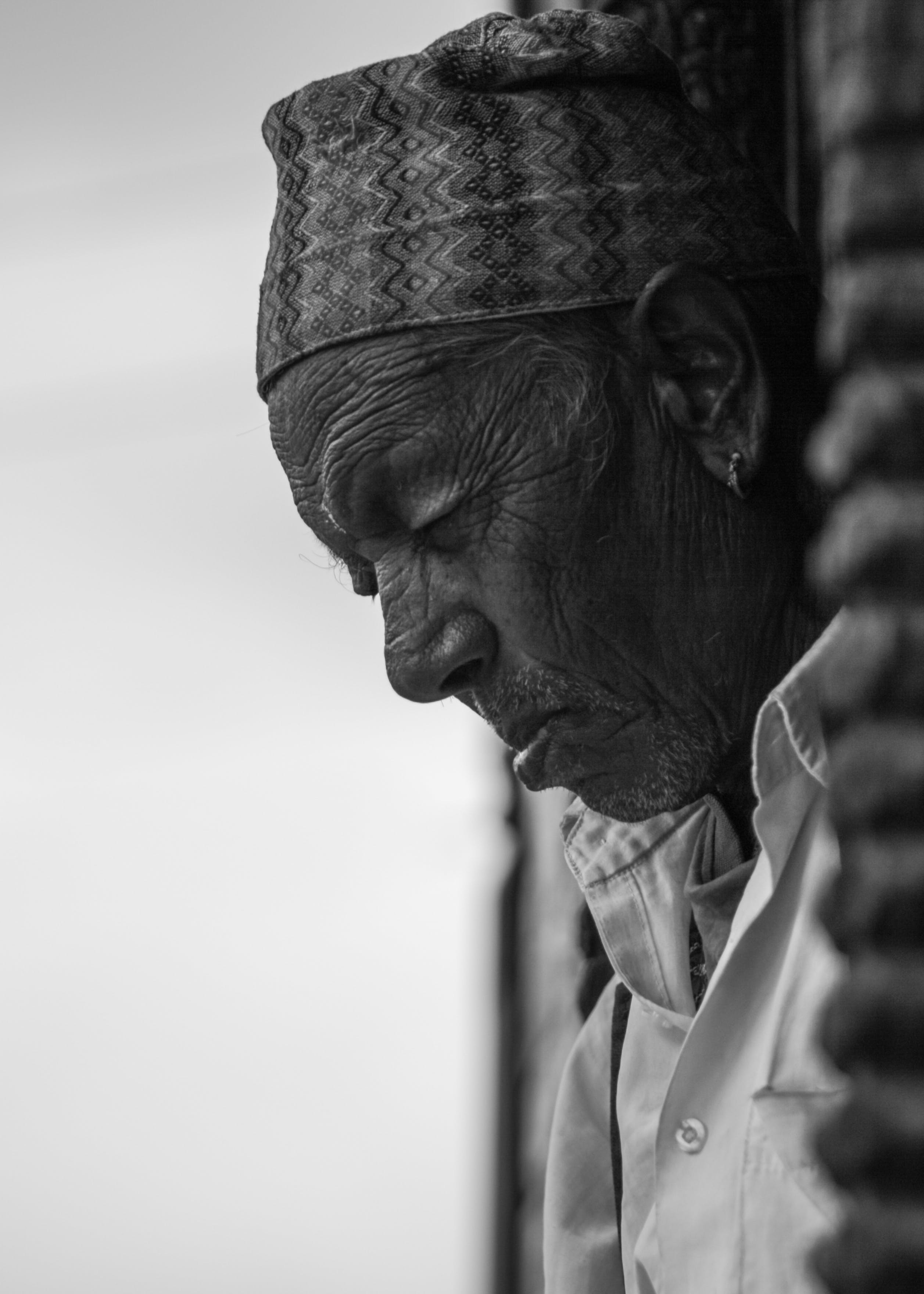 Grayscale Photo of a Man With Headdress