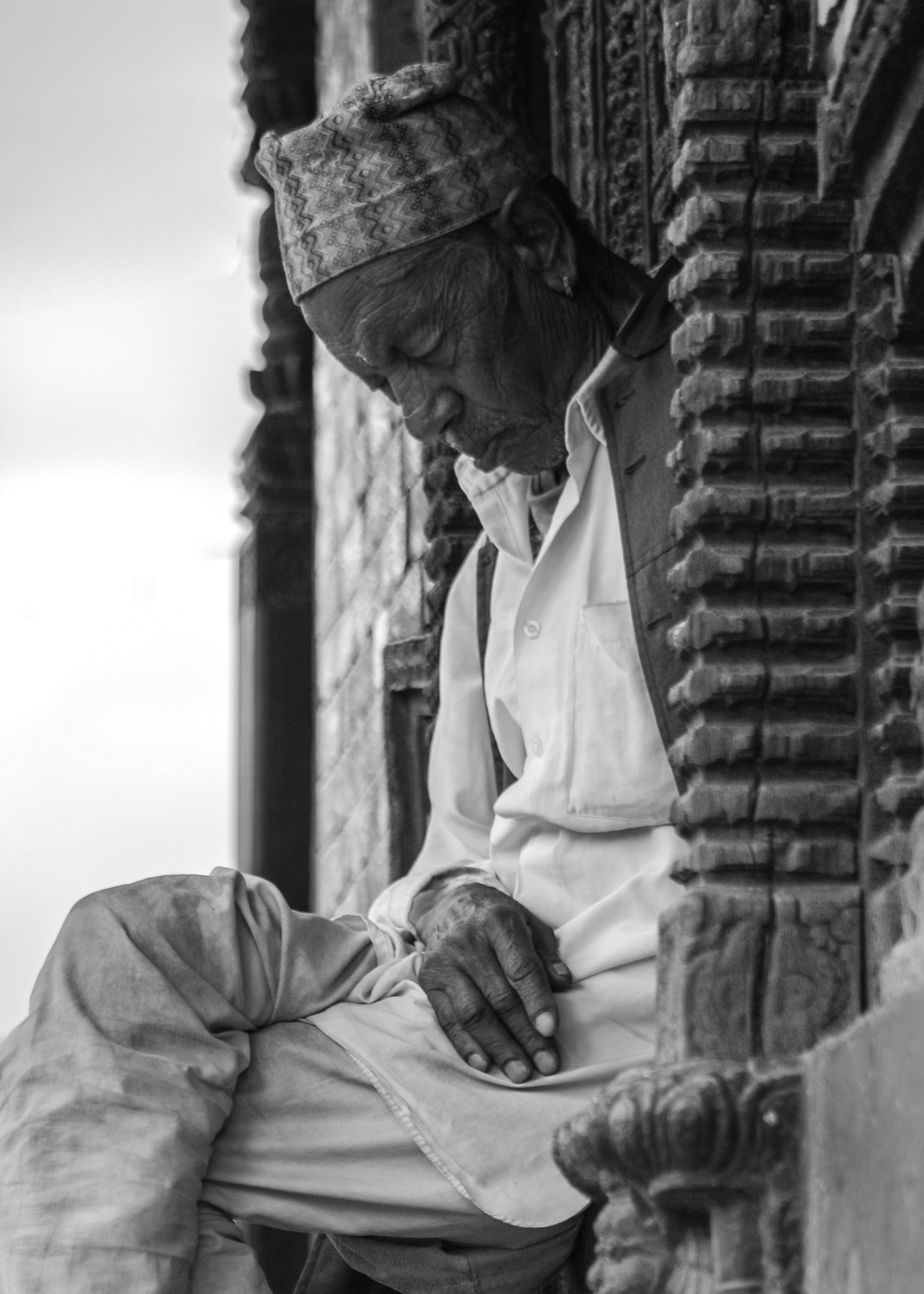 Grayscale Photo of Man Sleeping