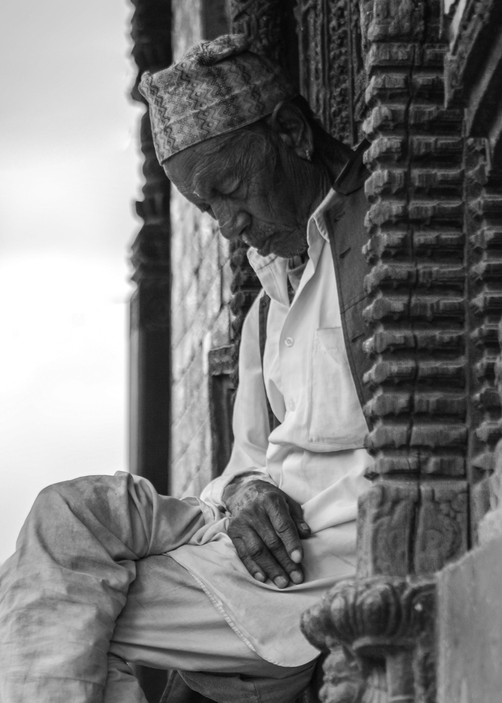 Grayscale Photo of Man Sleeping