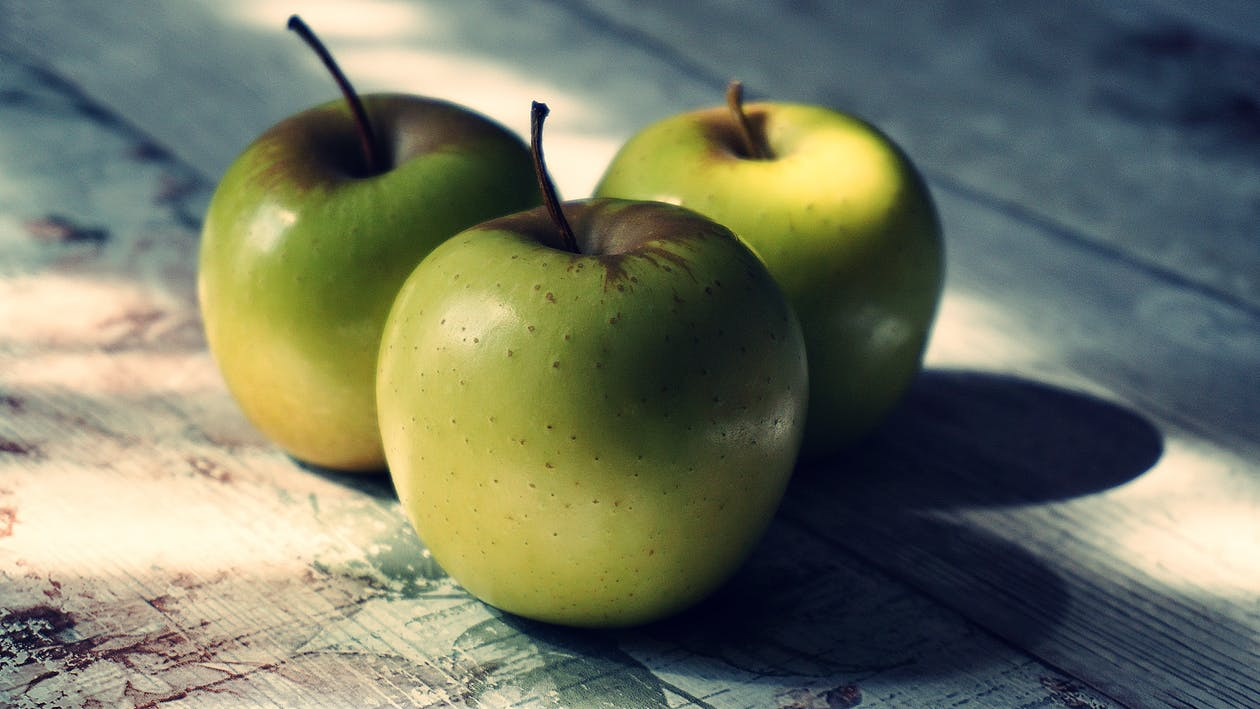Close-Up Photography of Three Green Apples