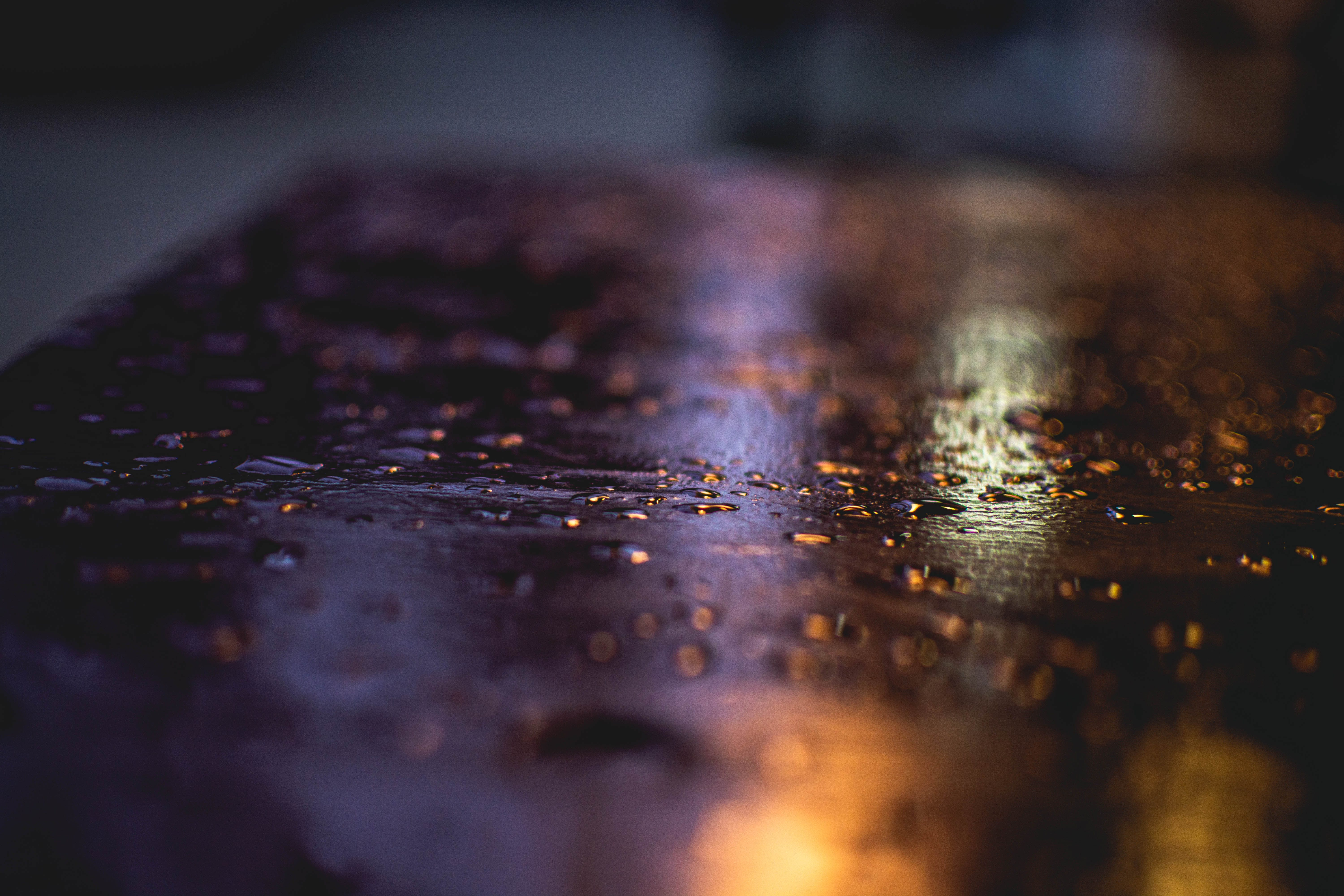 Close Up Photography of Water Droplets on Wooden Surface