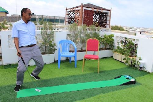 Foto profissional grátis de bola de golfe, homem