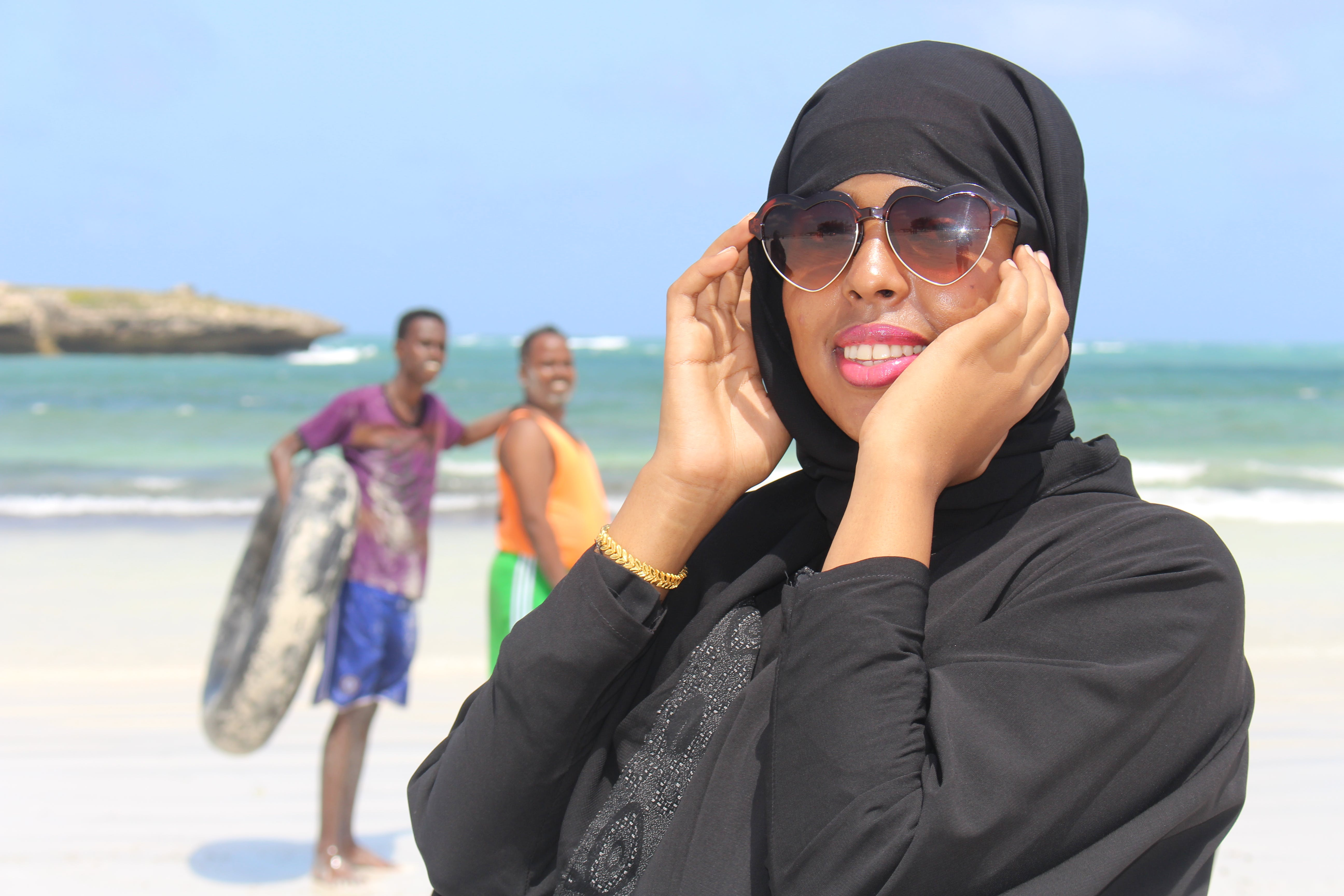 Woman Wearing Black Abaya Dress Holding Her