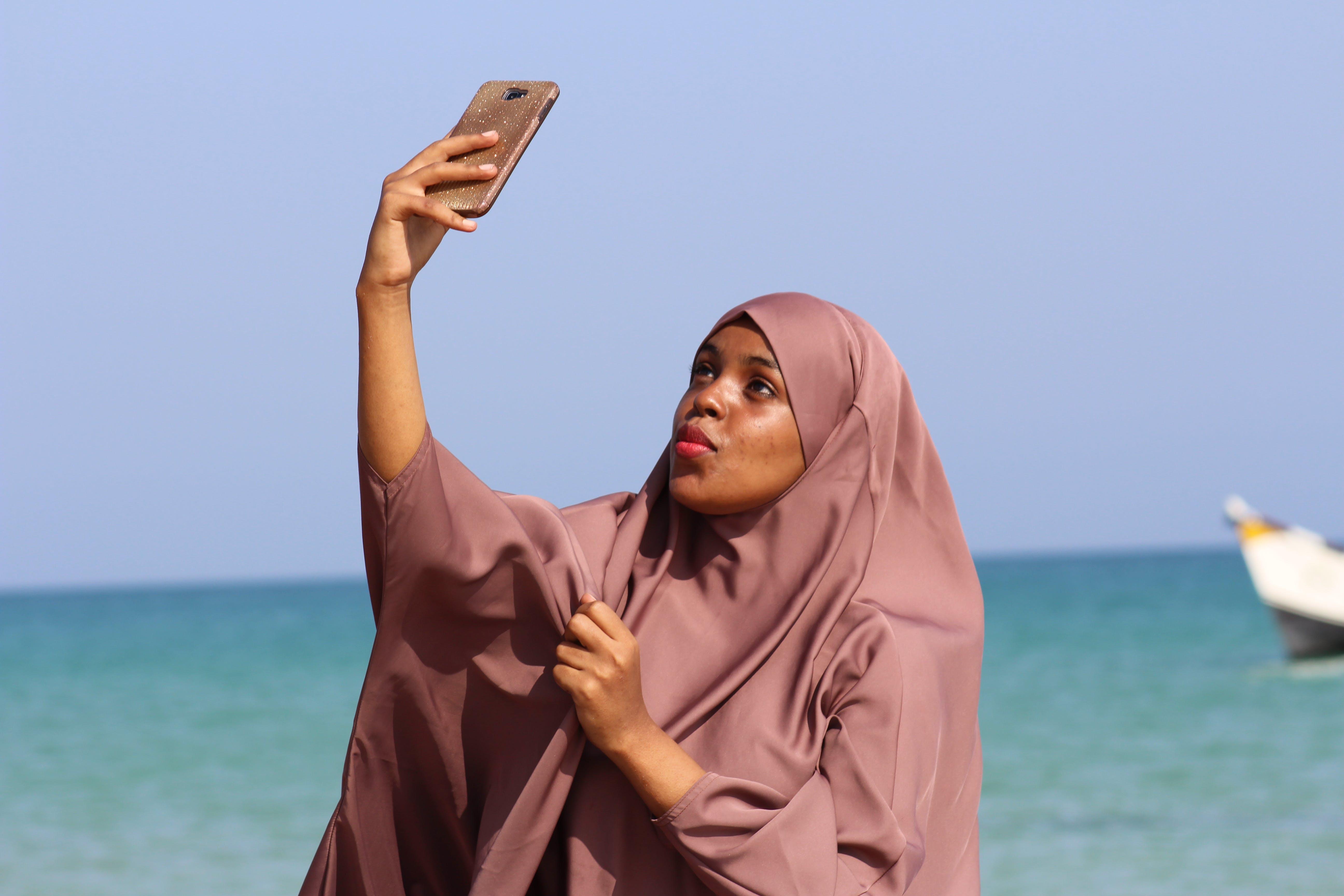 Woman Taking Selfie Near Shoreline