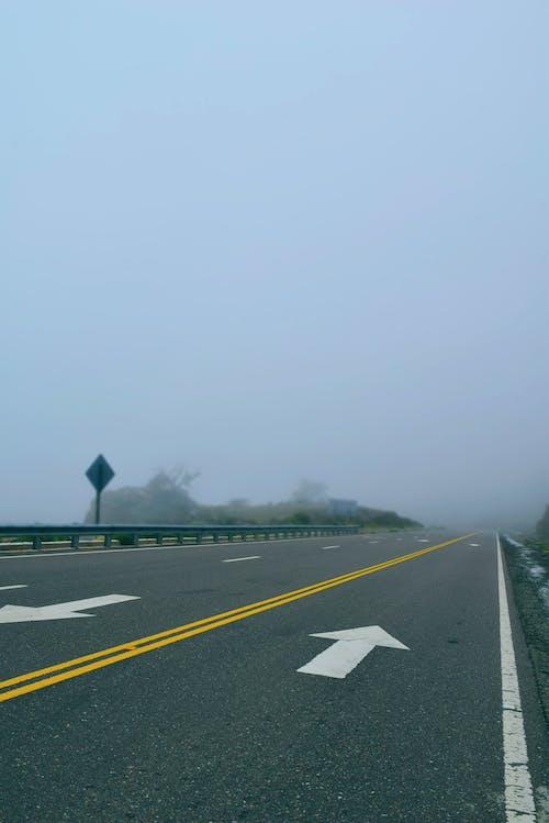 Asphalt Road Covered With Fog
