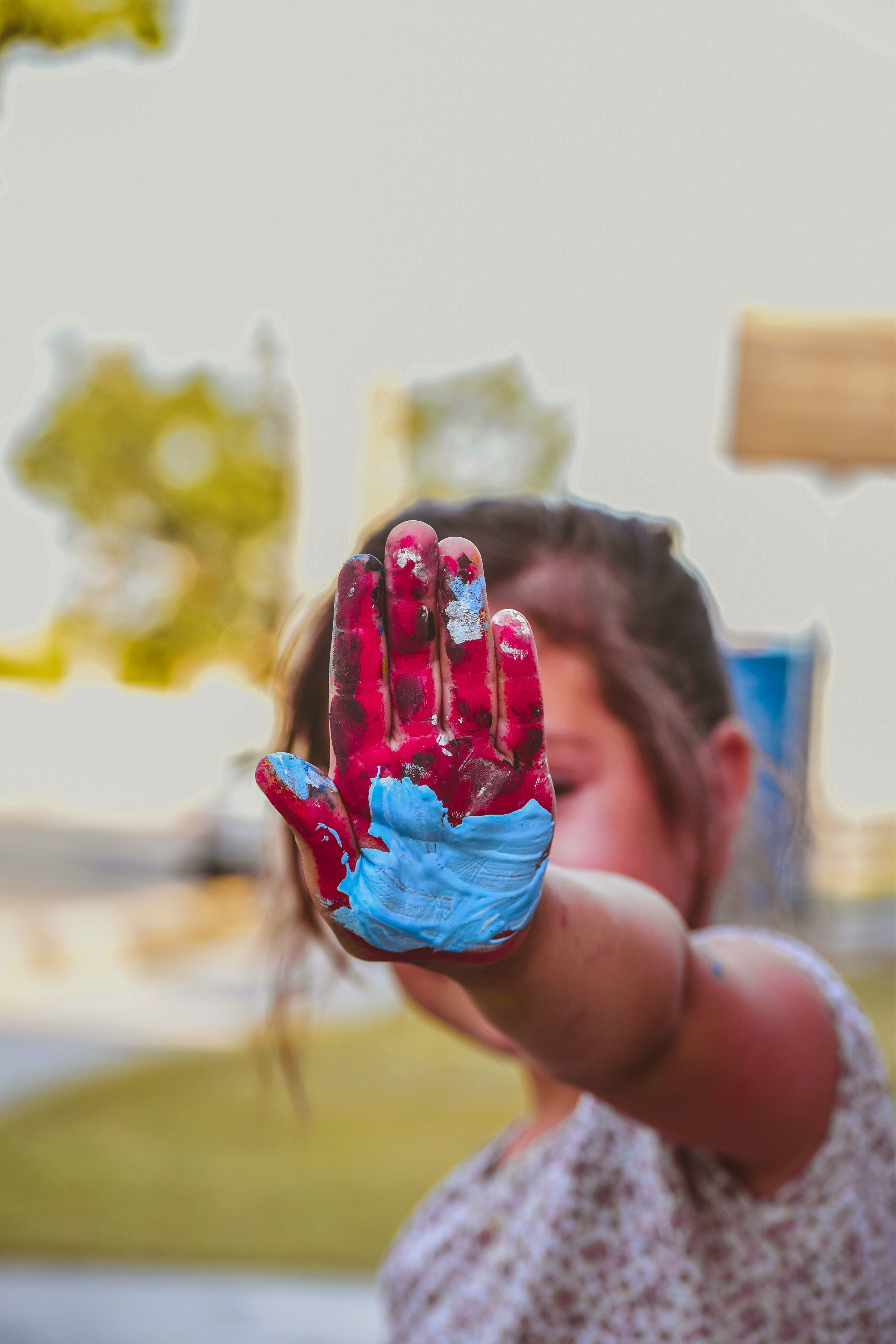 Girl Hand With Red and Blue Paint