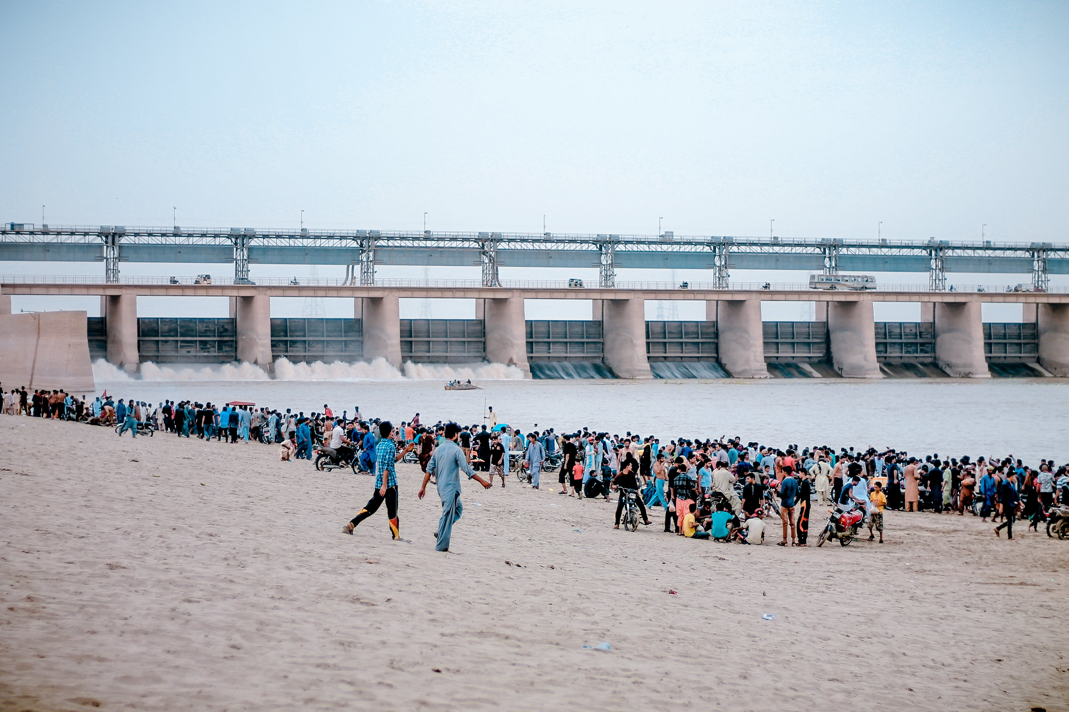 Photograph of a Crowd by the Water
