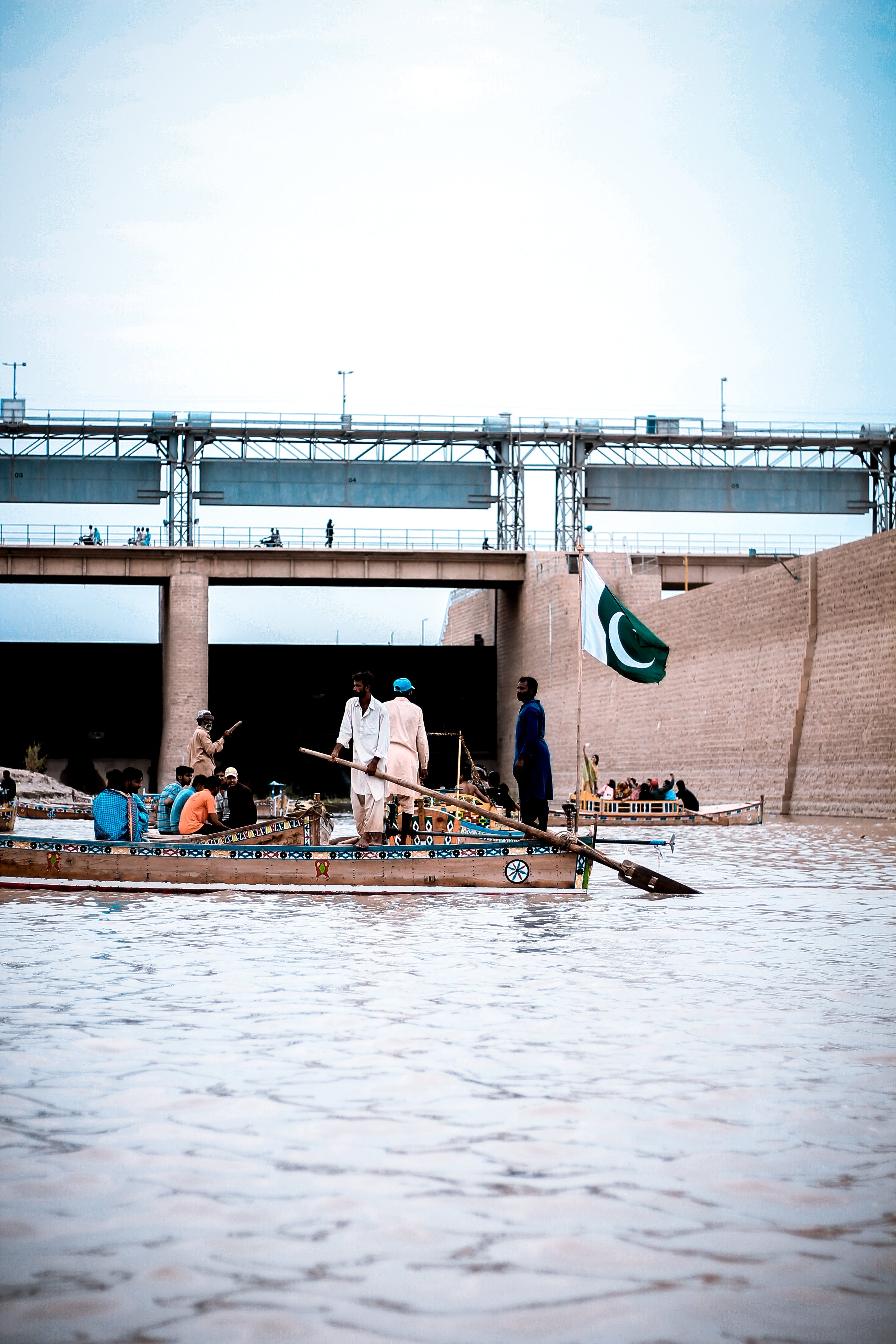 People Riding On Boat With Pakistan Flag