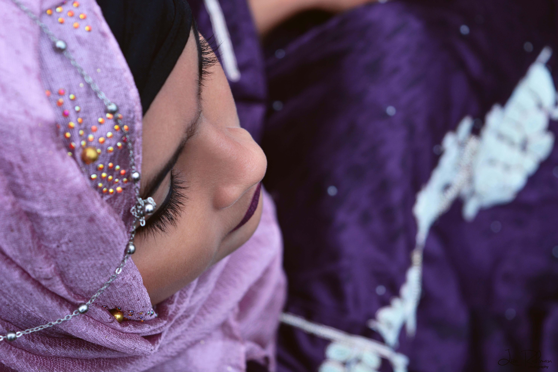 Closeup Photo of Woman in Purple Hijab Headscarf