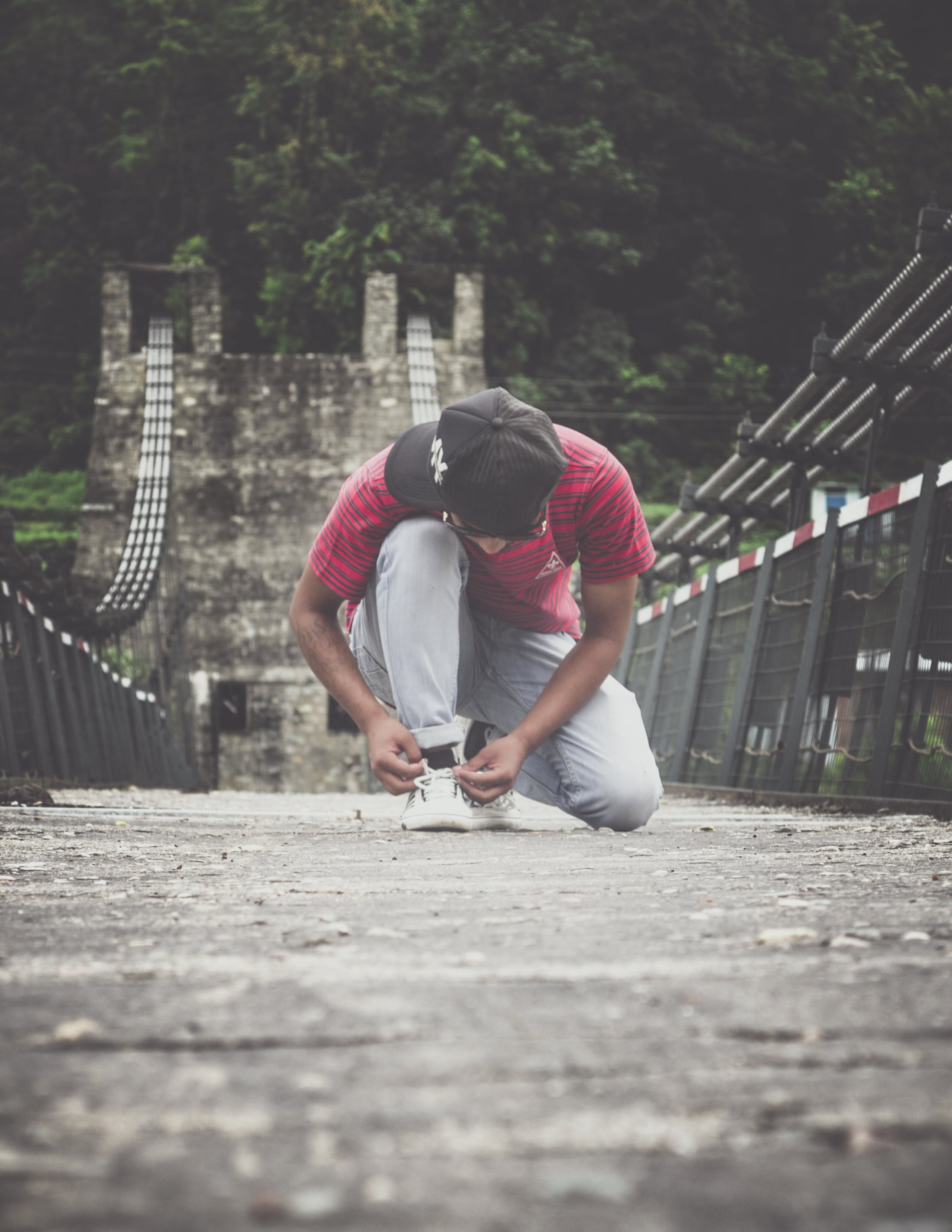 Person Tying His Shoe Lace