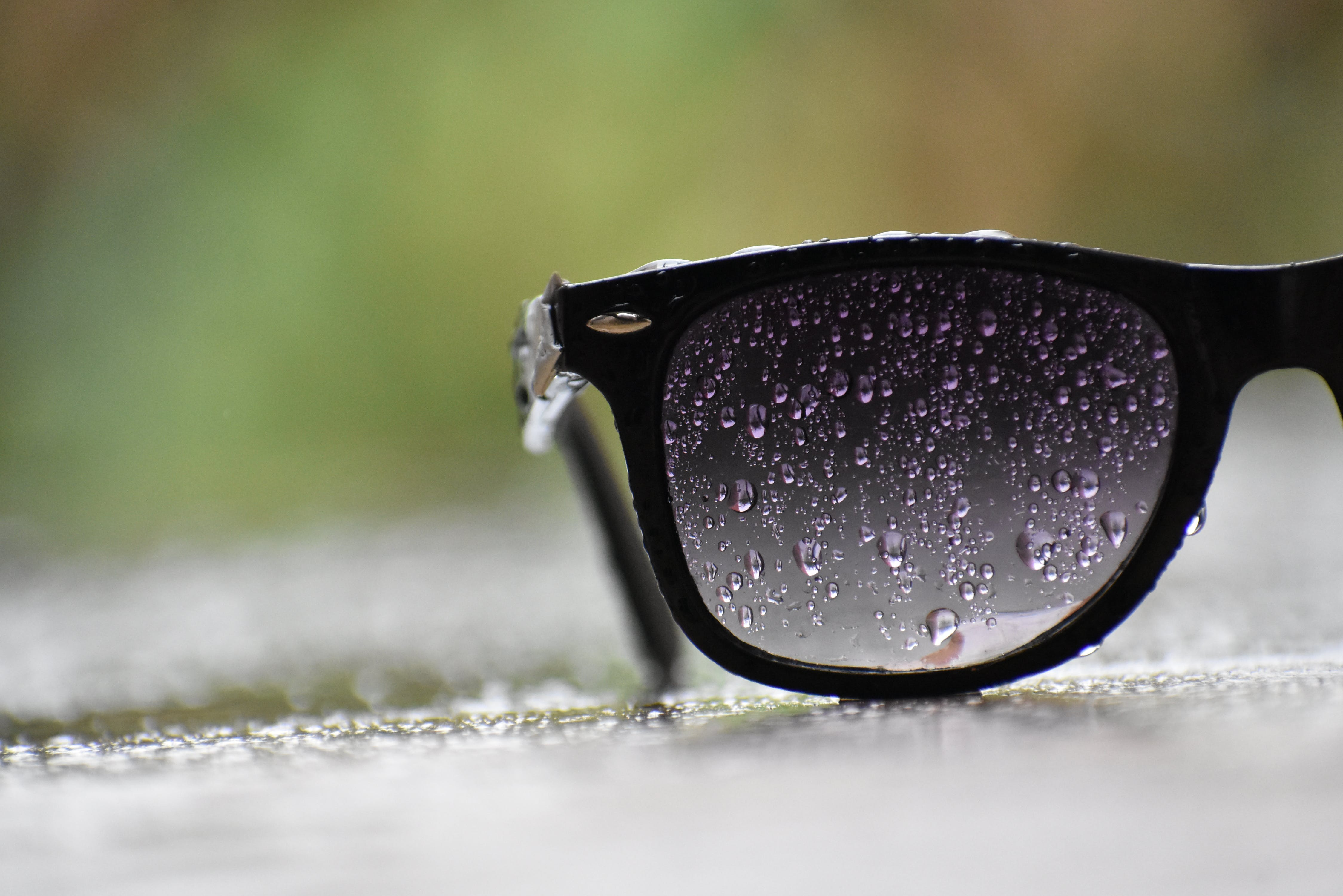 Black Sunglasses With Water Droplets