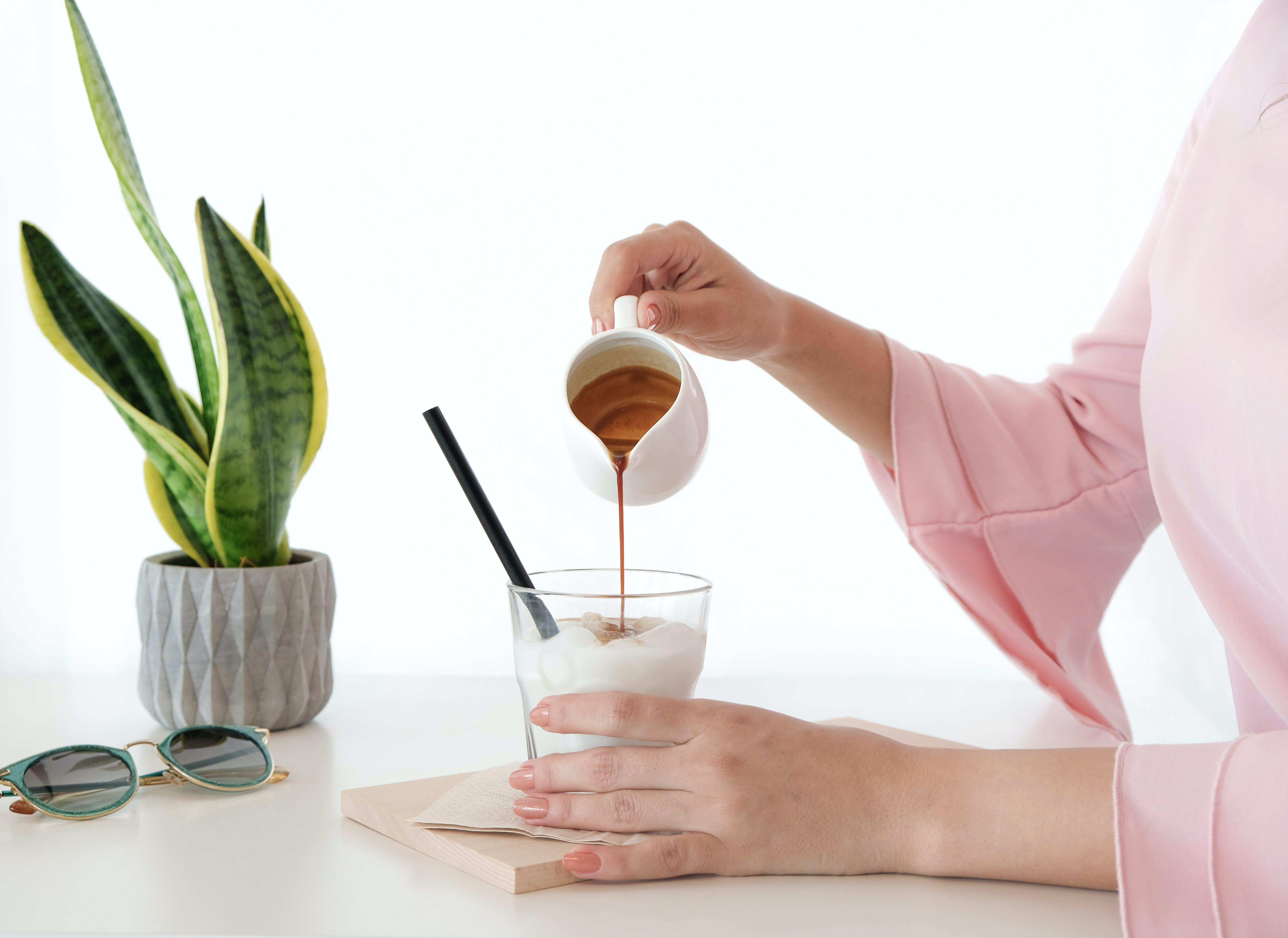 Woman Pouring Honey on Desert