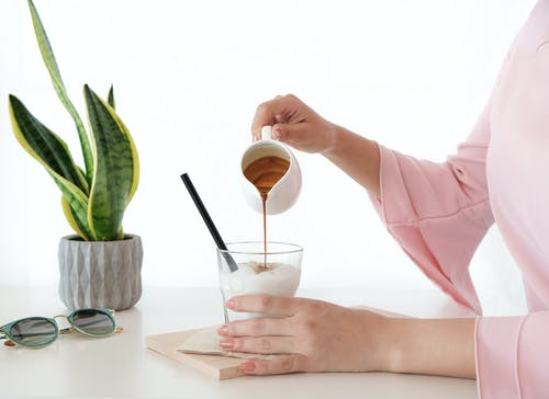Woman Pouring Honey on Desert