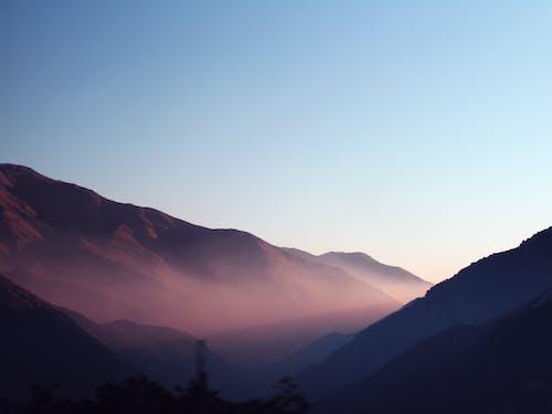 Foto stok gratis alam, langit biru, matahari terbenam, pegunungan