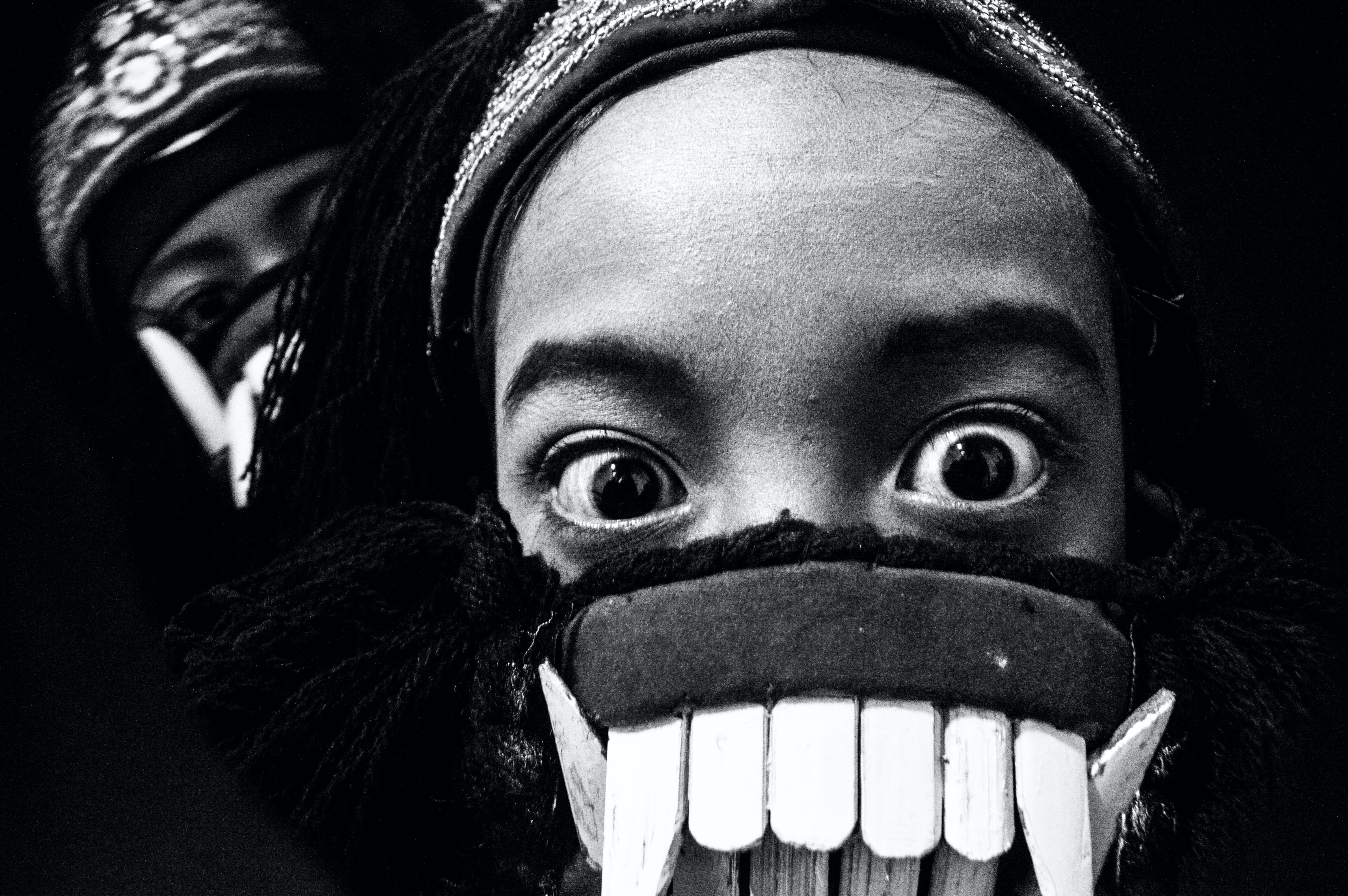 Grayscale Photo of Person in Mask Taking Selfie