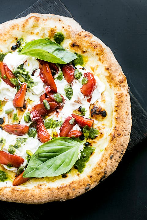 Baked Pizza with Basil Leaves