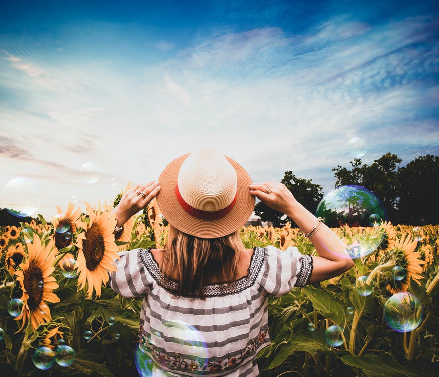 Standing Woman Surrounded of Sunflowers