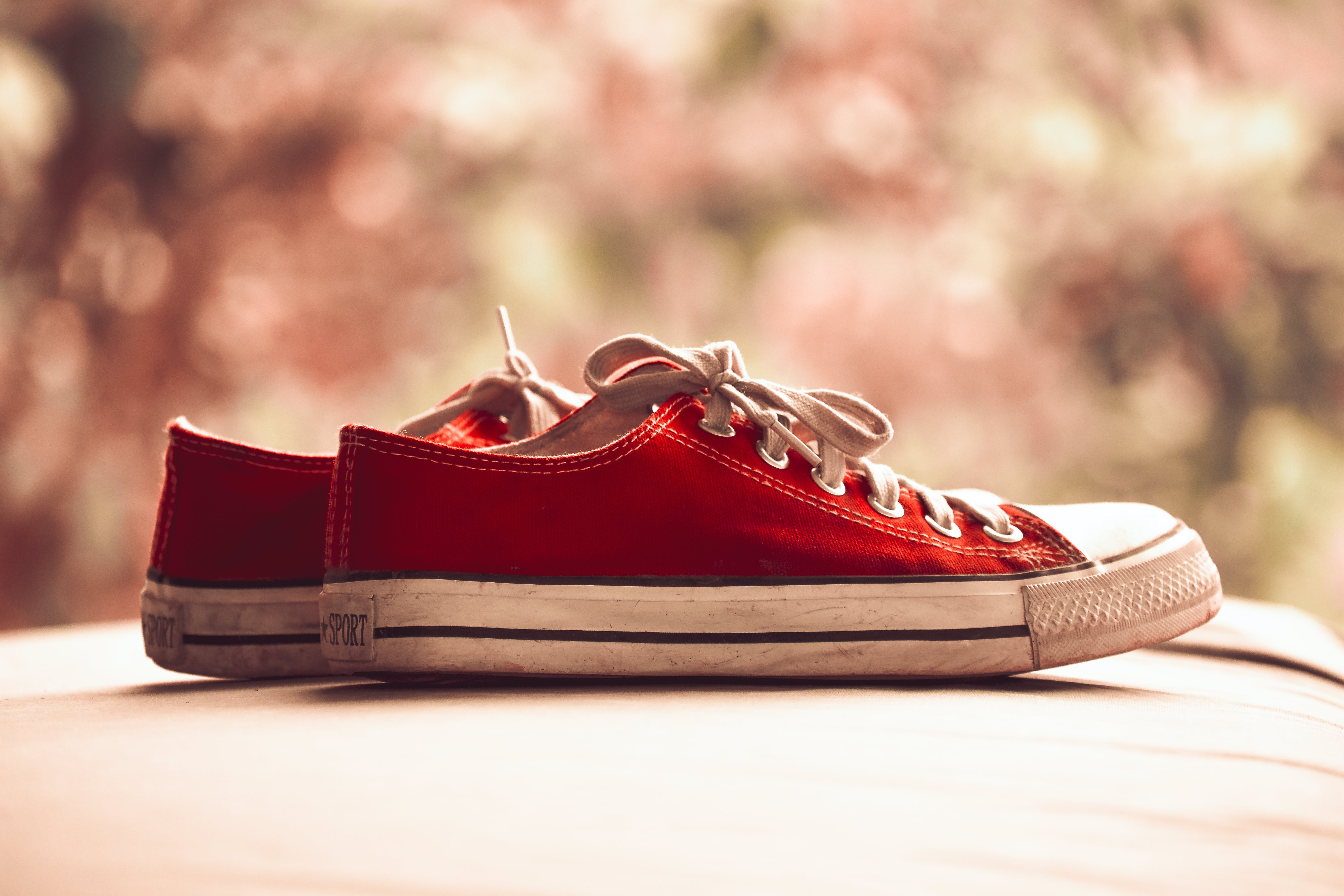 Pair of Red Low-top Sneakers in Bokeh Photography