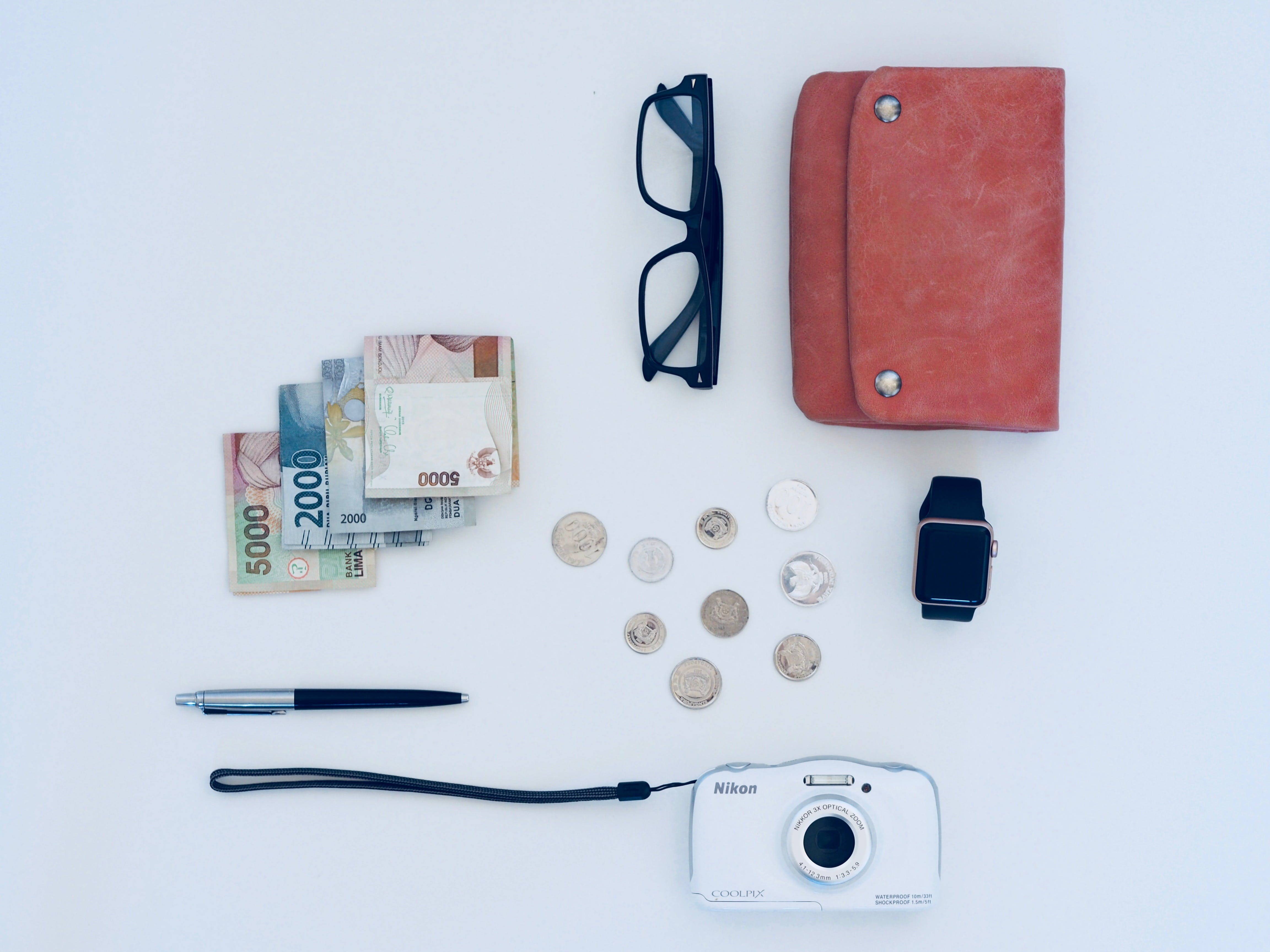 White Camera And Eyeglasses With Black Frame