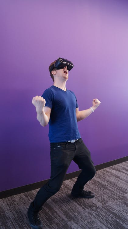 Photo of Man Using Virtual Reality Headset