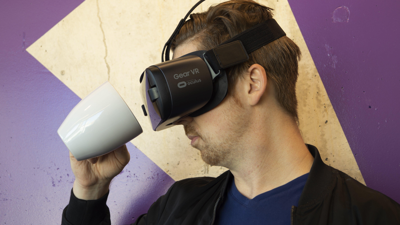 Man Wearing Virtual Reality Headset And Holding A Mug