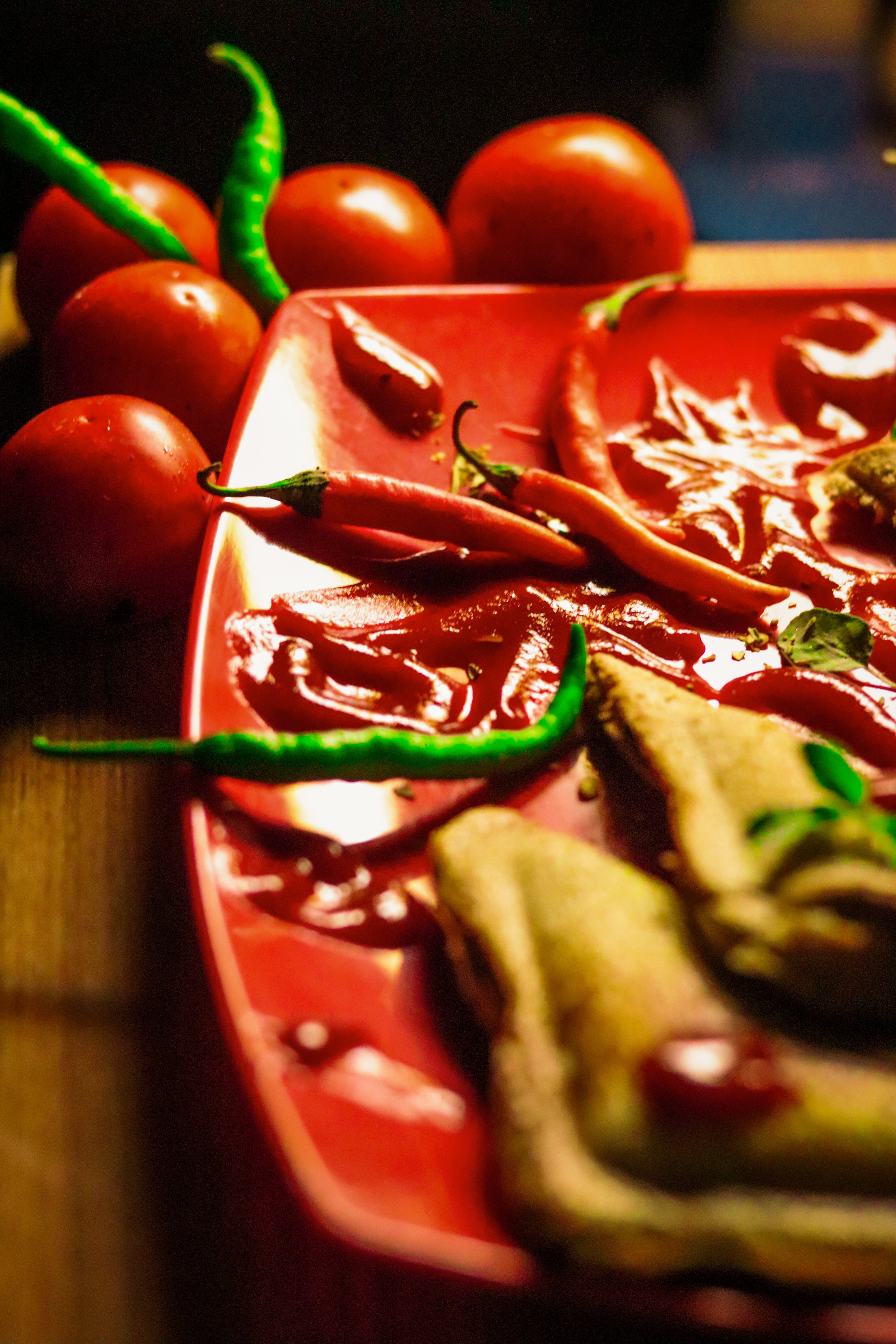 Shallow Focus Photography of Green and Red Chili on Plate