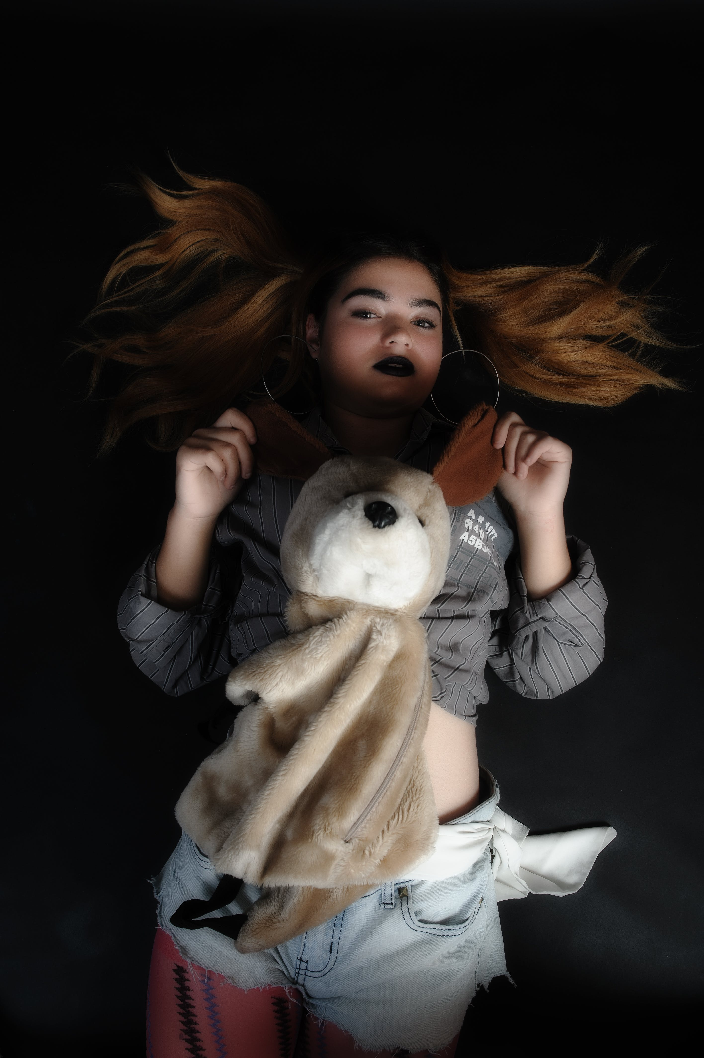 Woman Lying on Black Textile