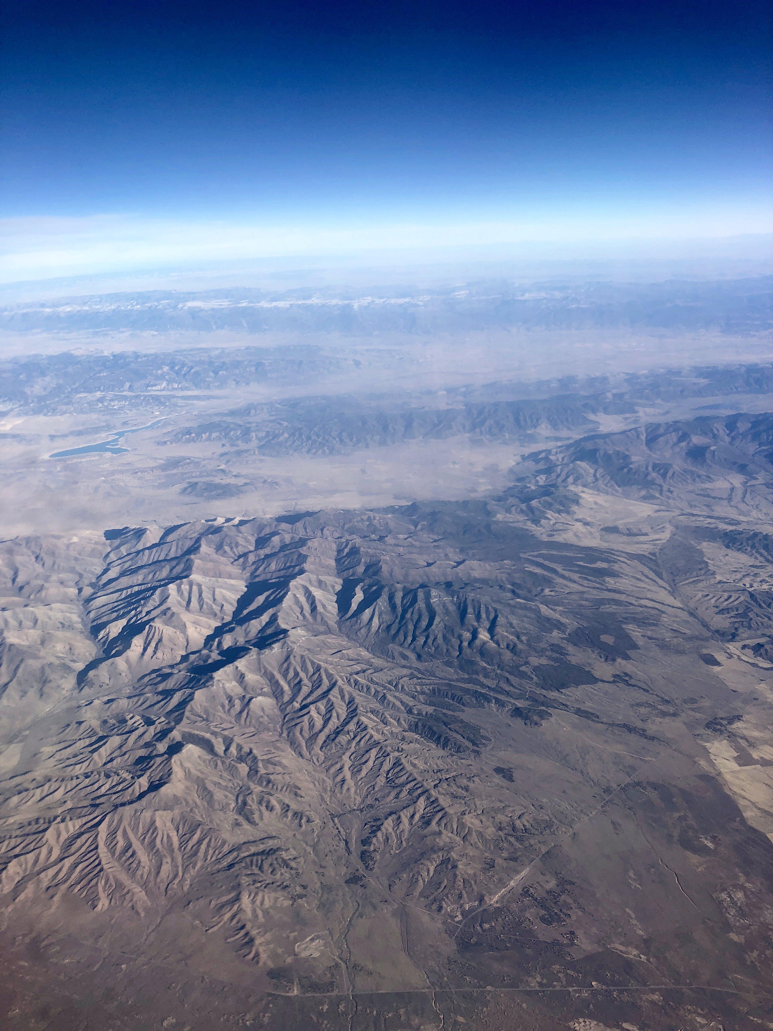 Fotos de stock gratuitas de ambiente, angulo alto, avión, cielo