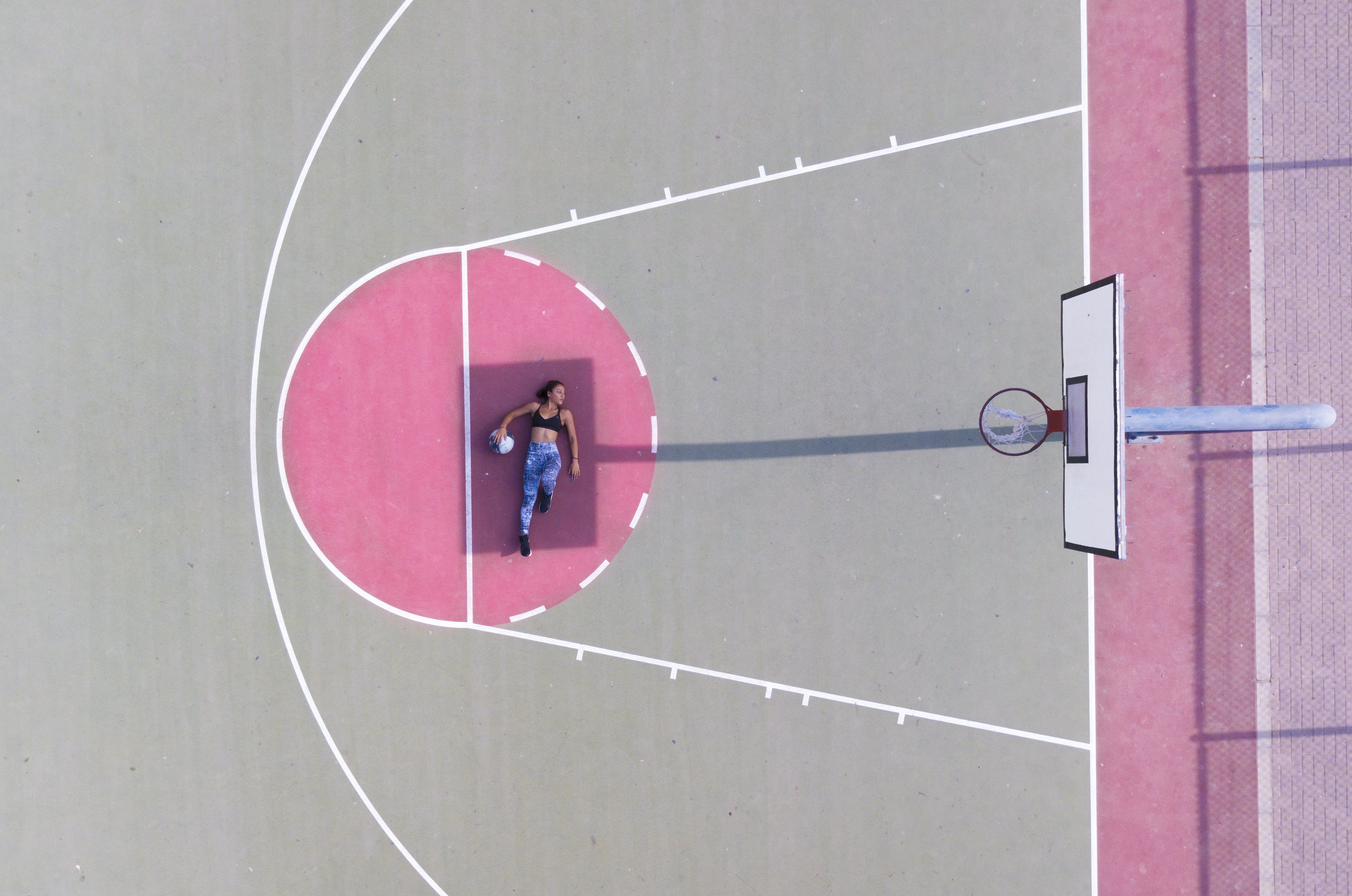 Woman Lying on Basketball Free Throw Line