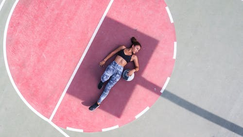 Woman Lying on Basketball Court