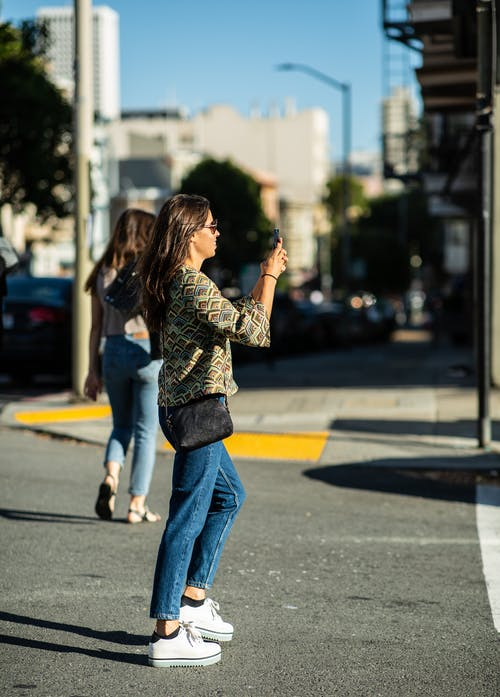 Free stock photo of cell phone, girl, picture taking, street